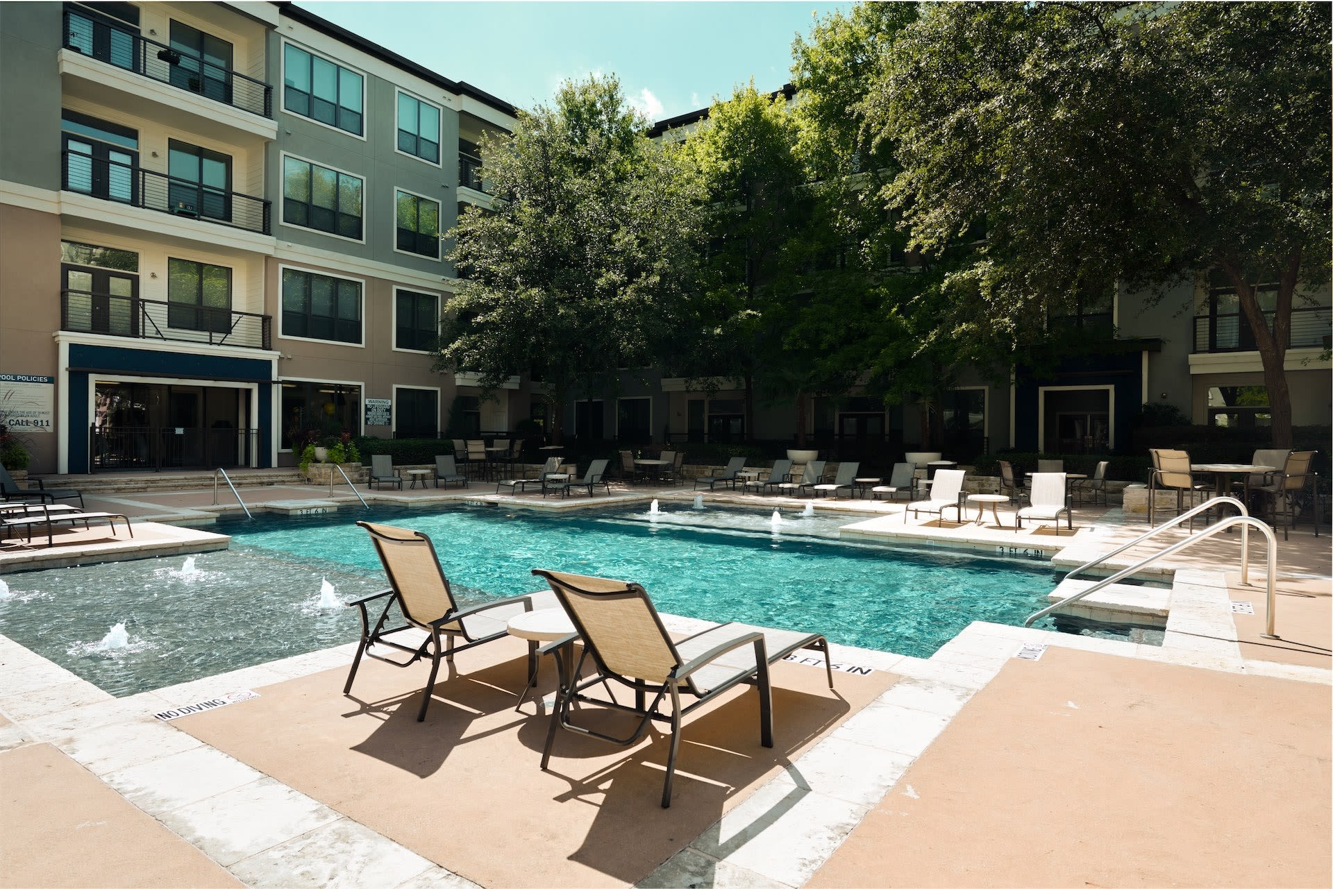 lounge by the pool at Seville Uptown in Dallas, Texas
