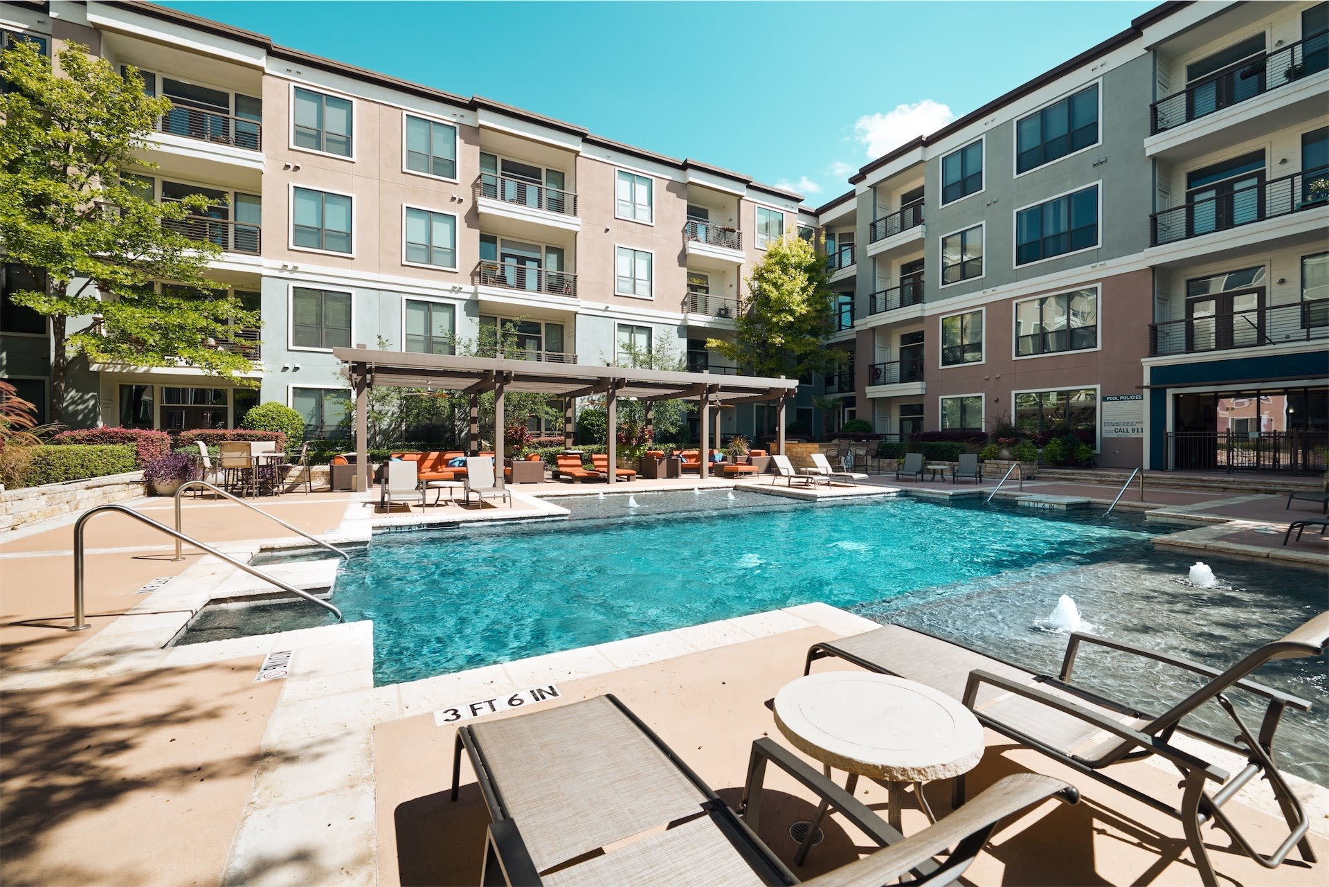 Sun bathing chairs to lounge in by the pool at Seville Uptown in Dallas, Texas
