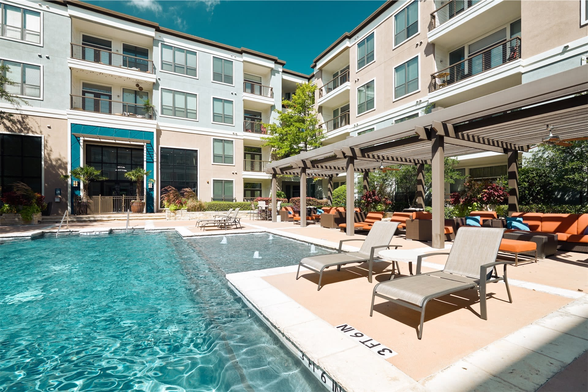 tons of covered lounge area for residents to relax at Seville Uptown in Dallas, Texas
