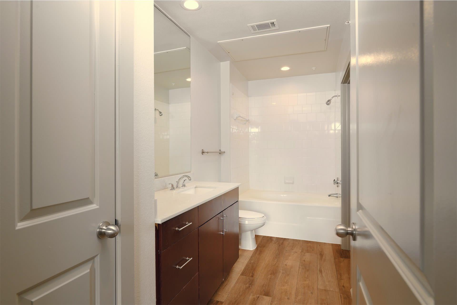 dark wood cabinet bathroom at Seville Uptown in Dallas, Texas