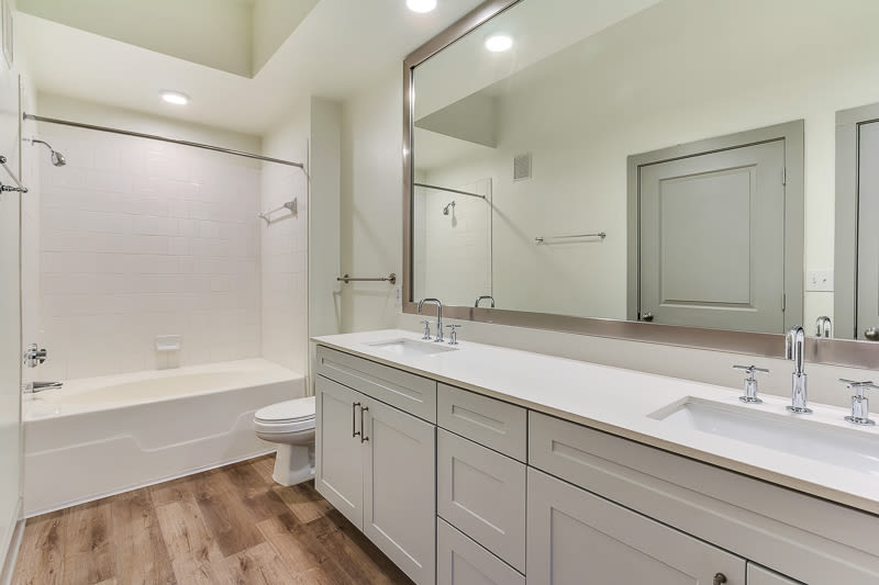 large bathroom with large mirror at Seville Uptown in Dallas, Texas