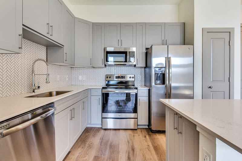 kitchen with steel appliances at Seville Uptown in Dallas, Texas