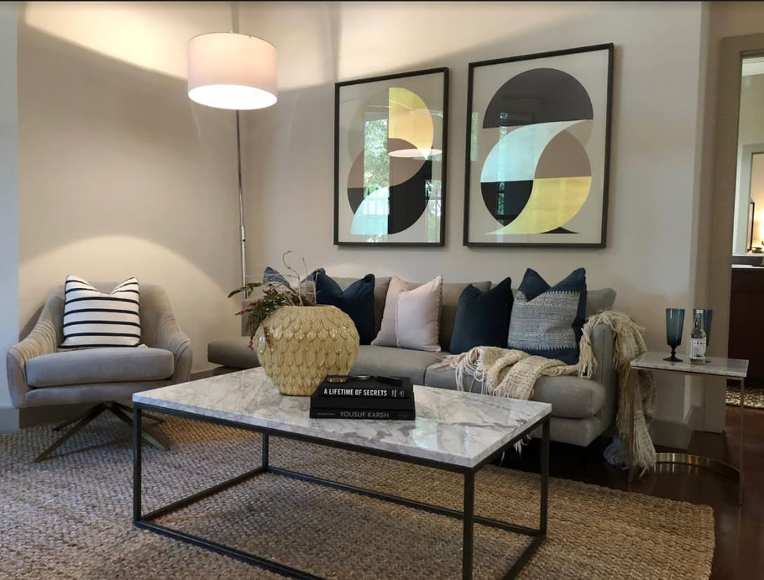 Living room with center table and wall art at Seville Uptown in Dallas, Texas