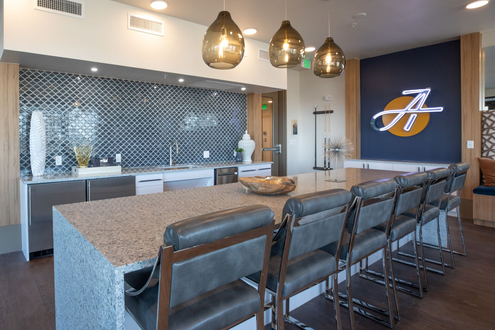 Kitchen area with bar seating at The Alcott in Downtown Denver, Colorado