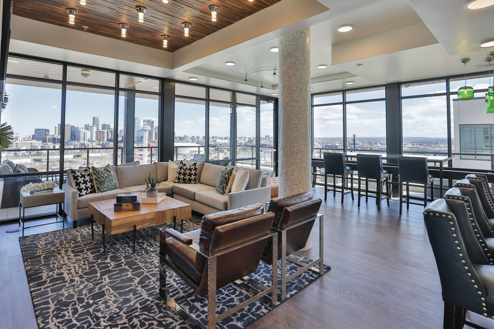 Comfortable seating with city views at The Alcott in Downtown Denver, Colorado