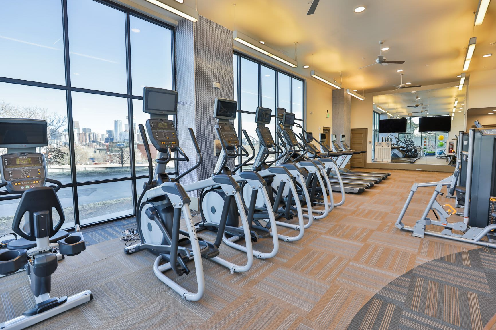 Well equipped fitness center at The Alcott in Downtown Denver, Colorado