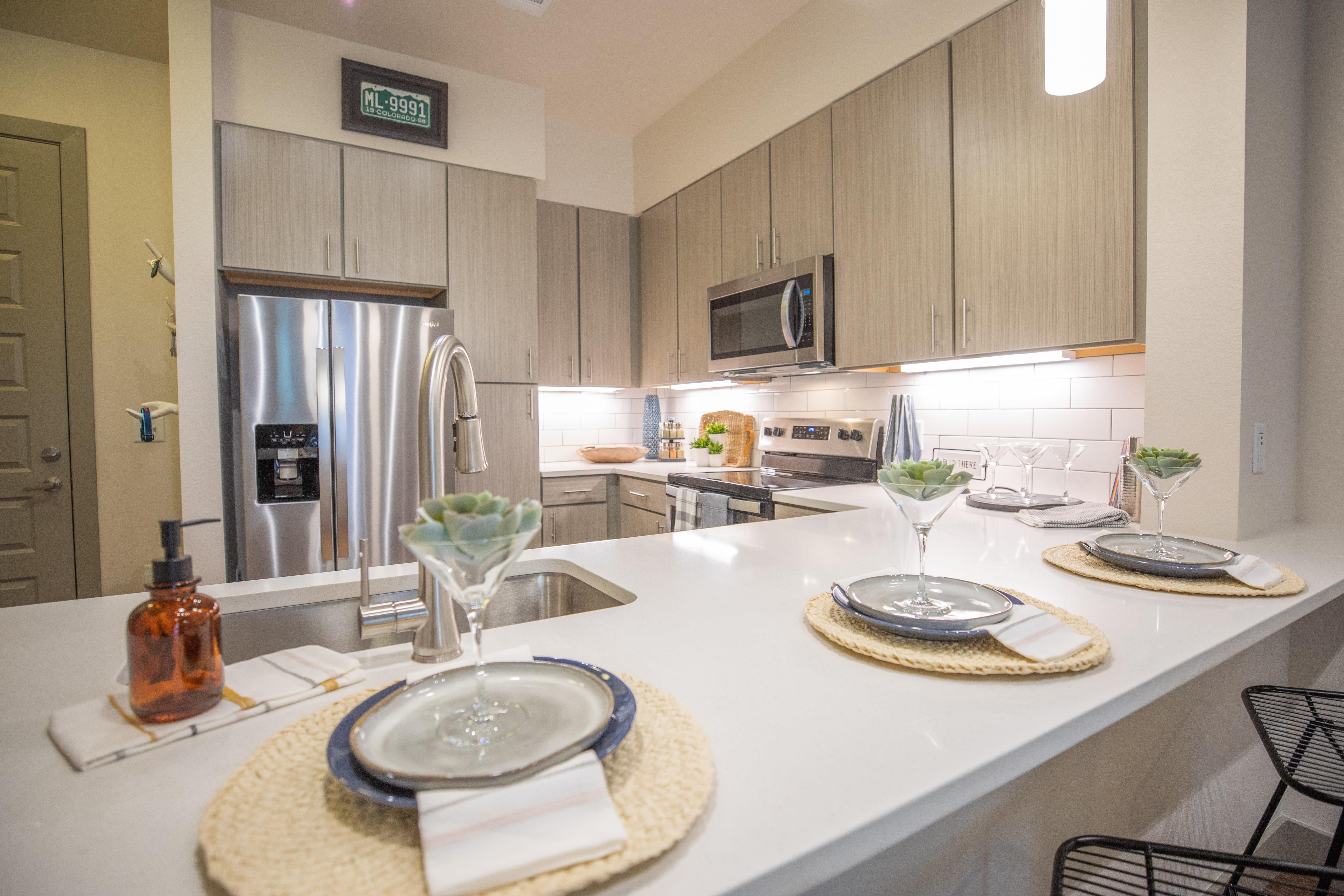 Clean minimalistic steel appliance kitchen at The Alcott in Denver, Colorado