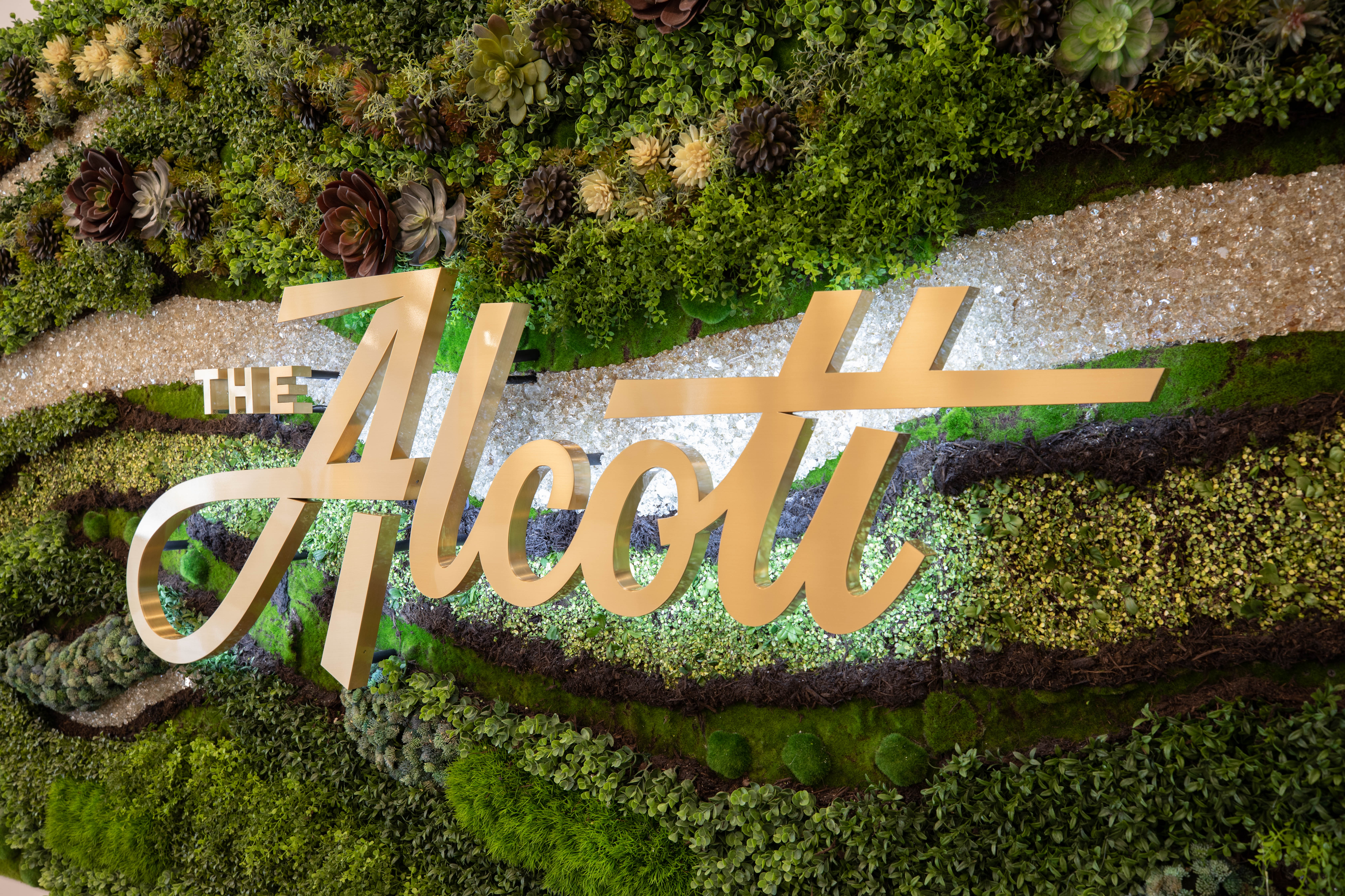 The Alcott sign on a living wall in Denver, Colorado
