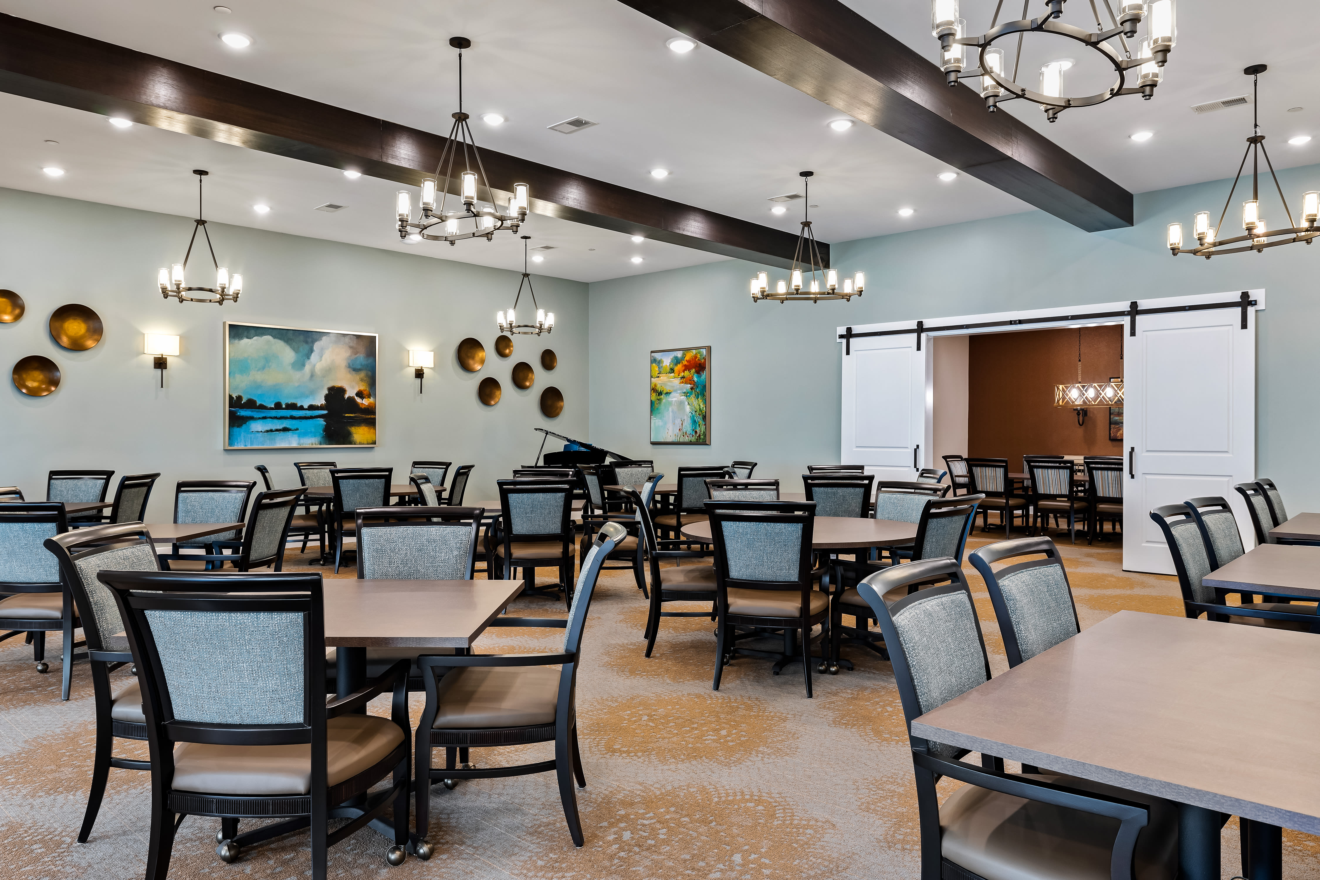Comfortable and modern dining hall of The Claiborne at Newnan Lakes in Newnan, GA