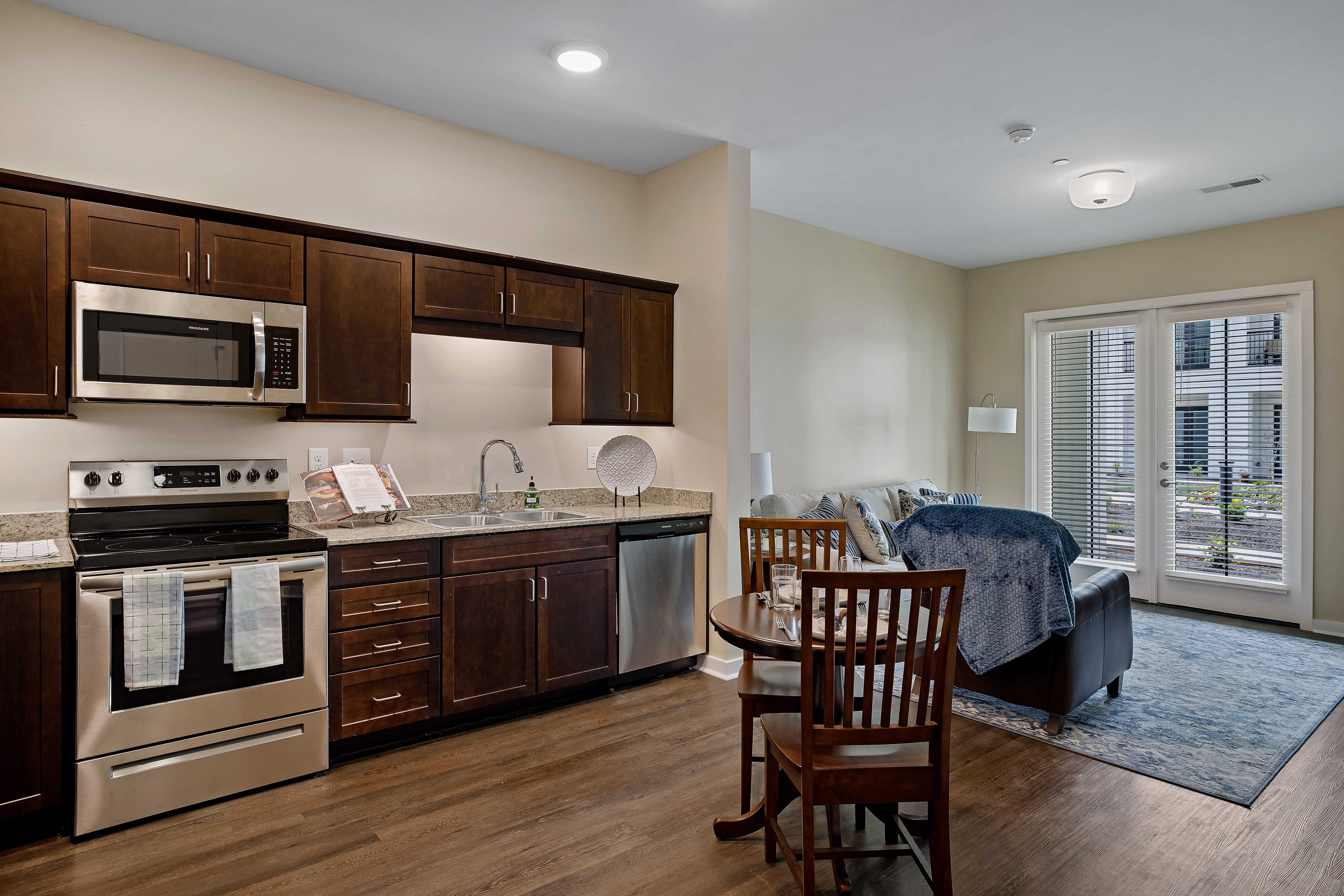 Dark wood cabinets and steel appliance home at The Claiborne at Newnan Lakes in Newnan, GA
