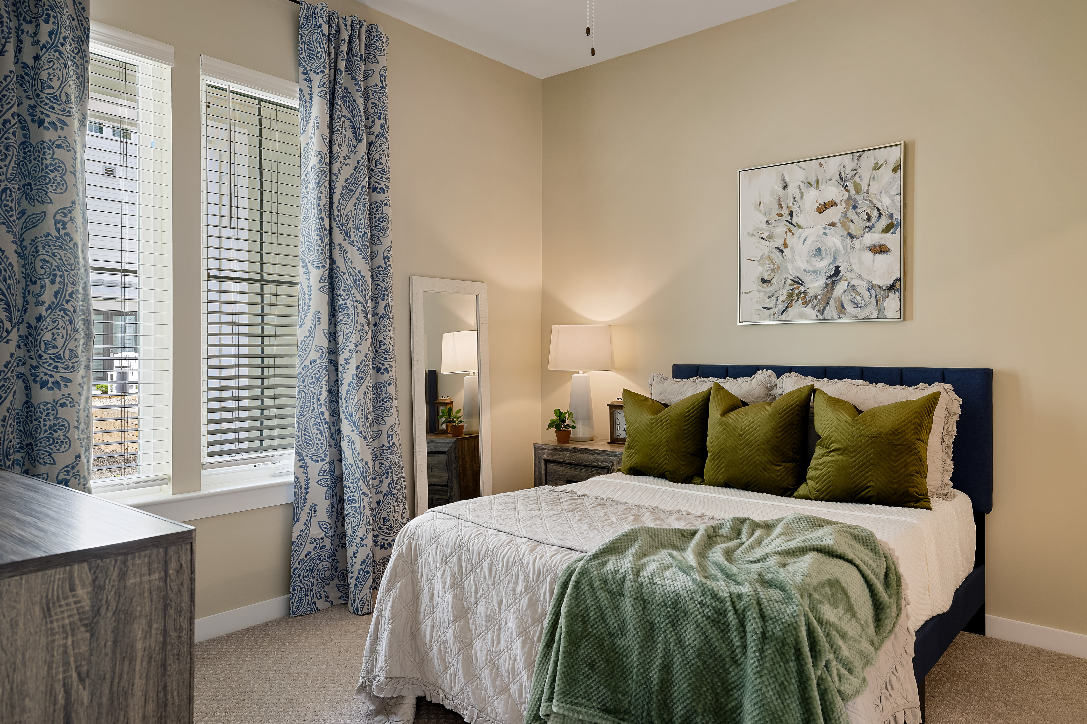 Relaxing bedroom with accented walls at The Claiborne at Newnan Lakes in Newnan, GA