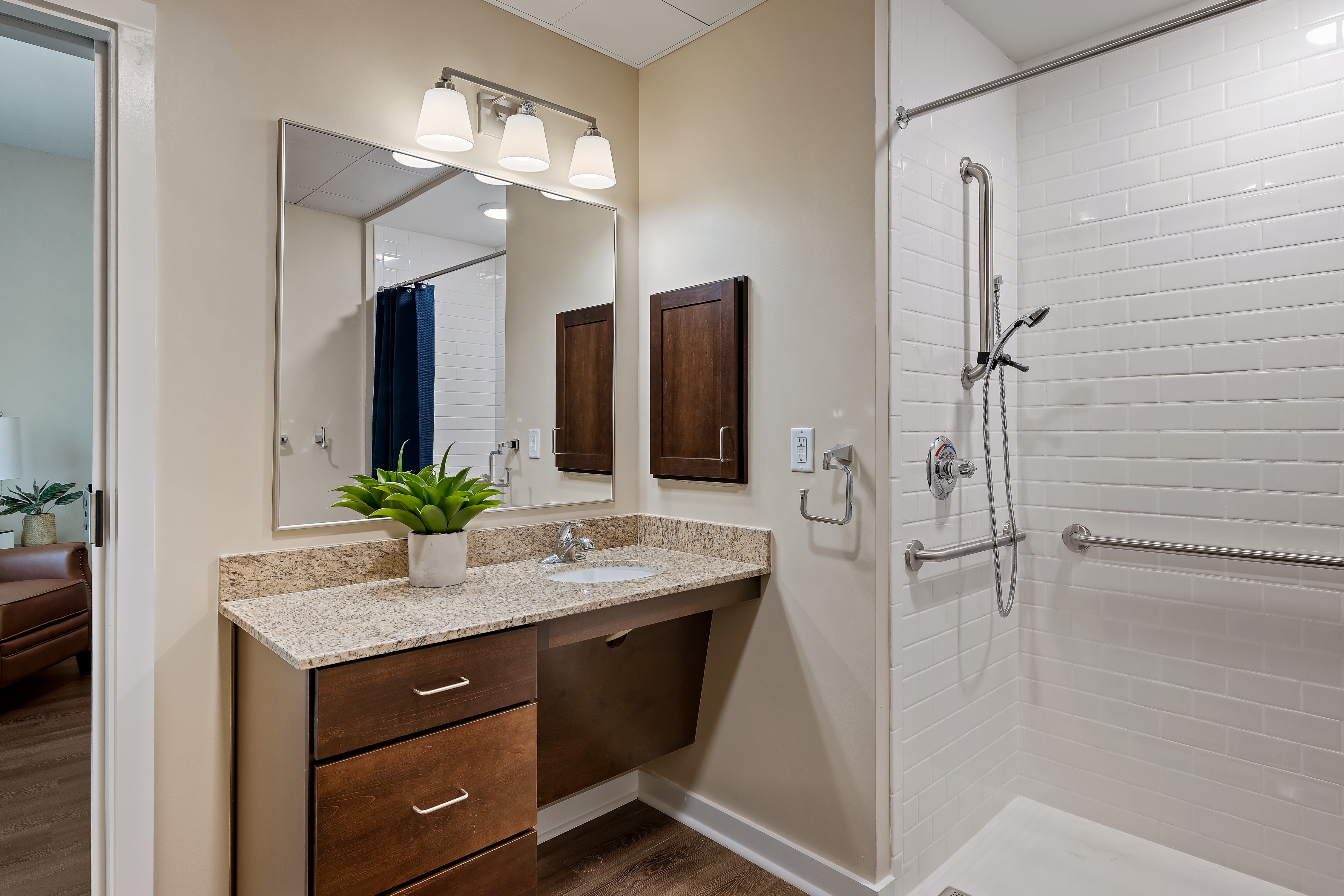 Easy access shower and wood finish sink at The Claiborne at Newnan Lakes in Newnan, GA