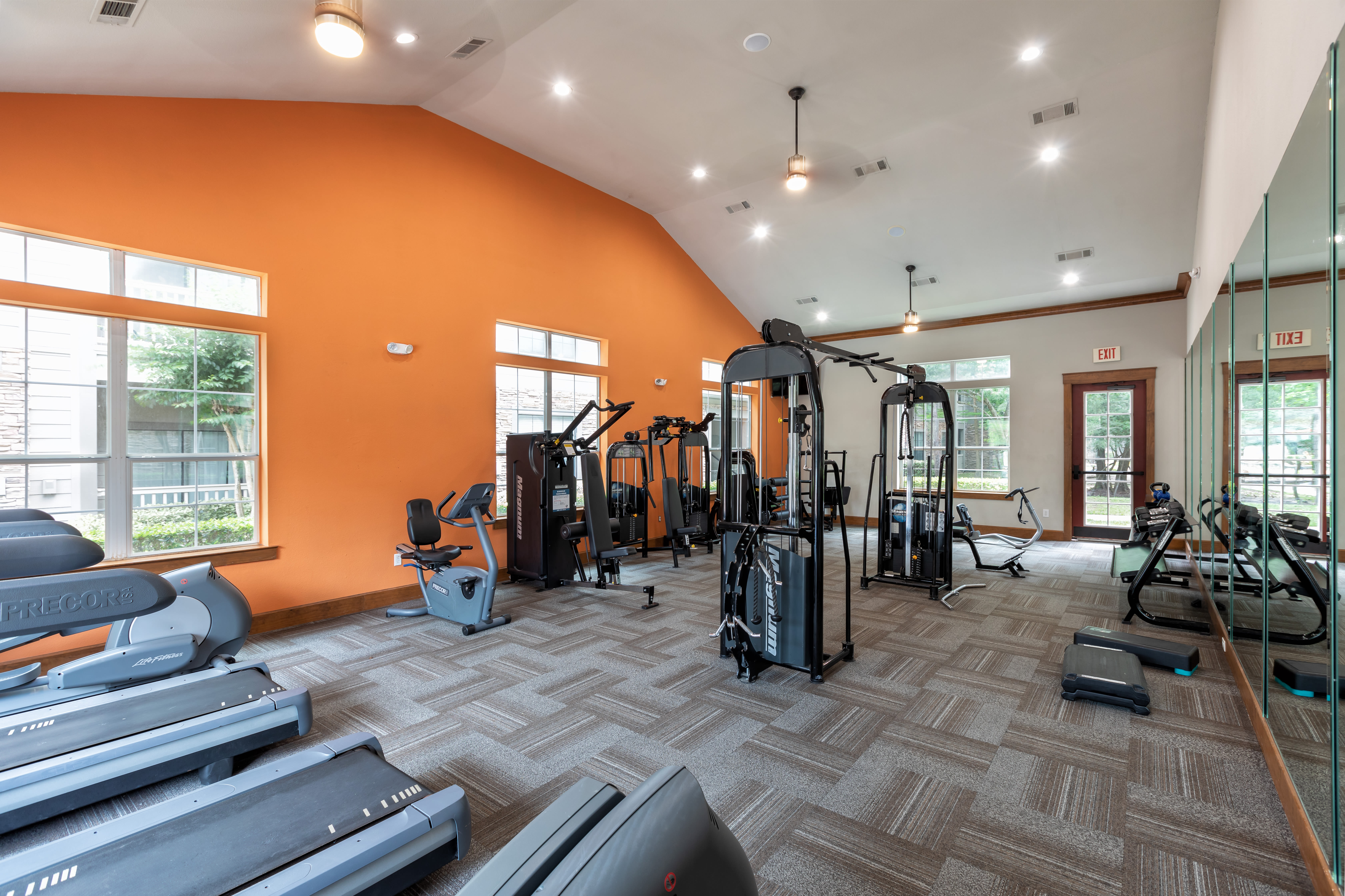 Well-equipped fitness center with terrific view of the community at Stone Creek at The Woodlands in The Woodlands, Texas