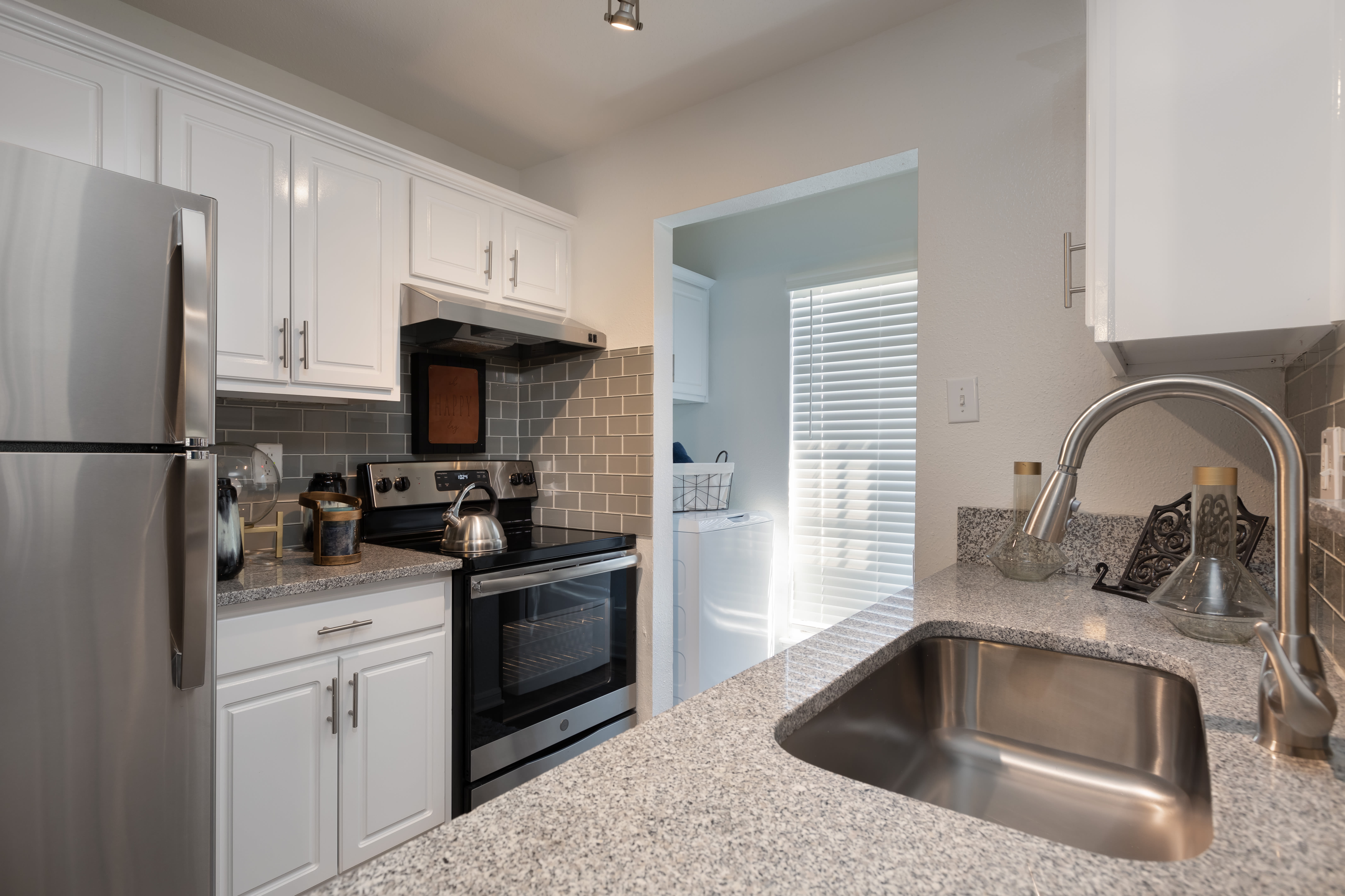Stainless-steel sink with white cabinets at McAlister in Webster, Texas
