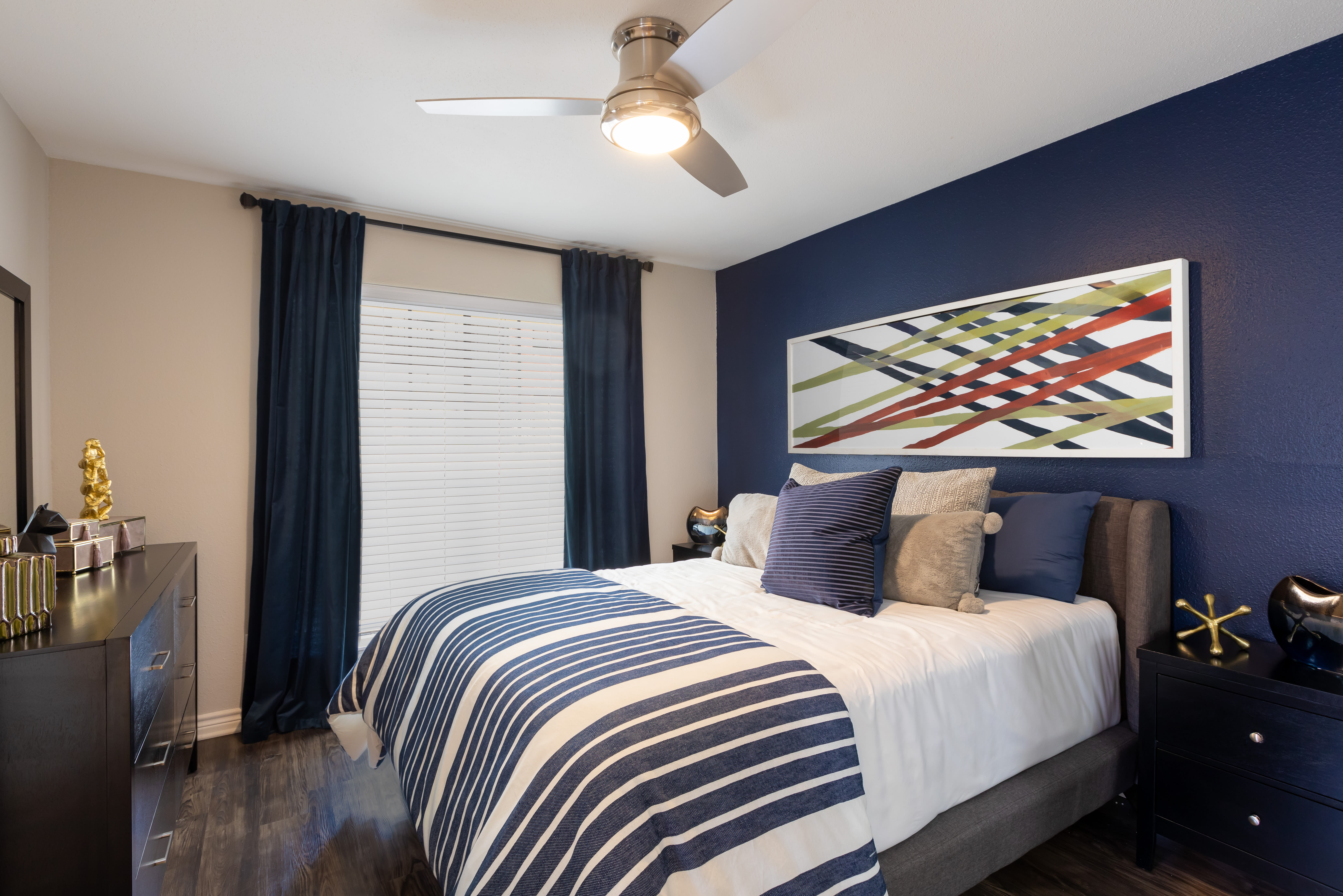 A furnished bedroom at McAlister in Webster, Texas