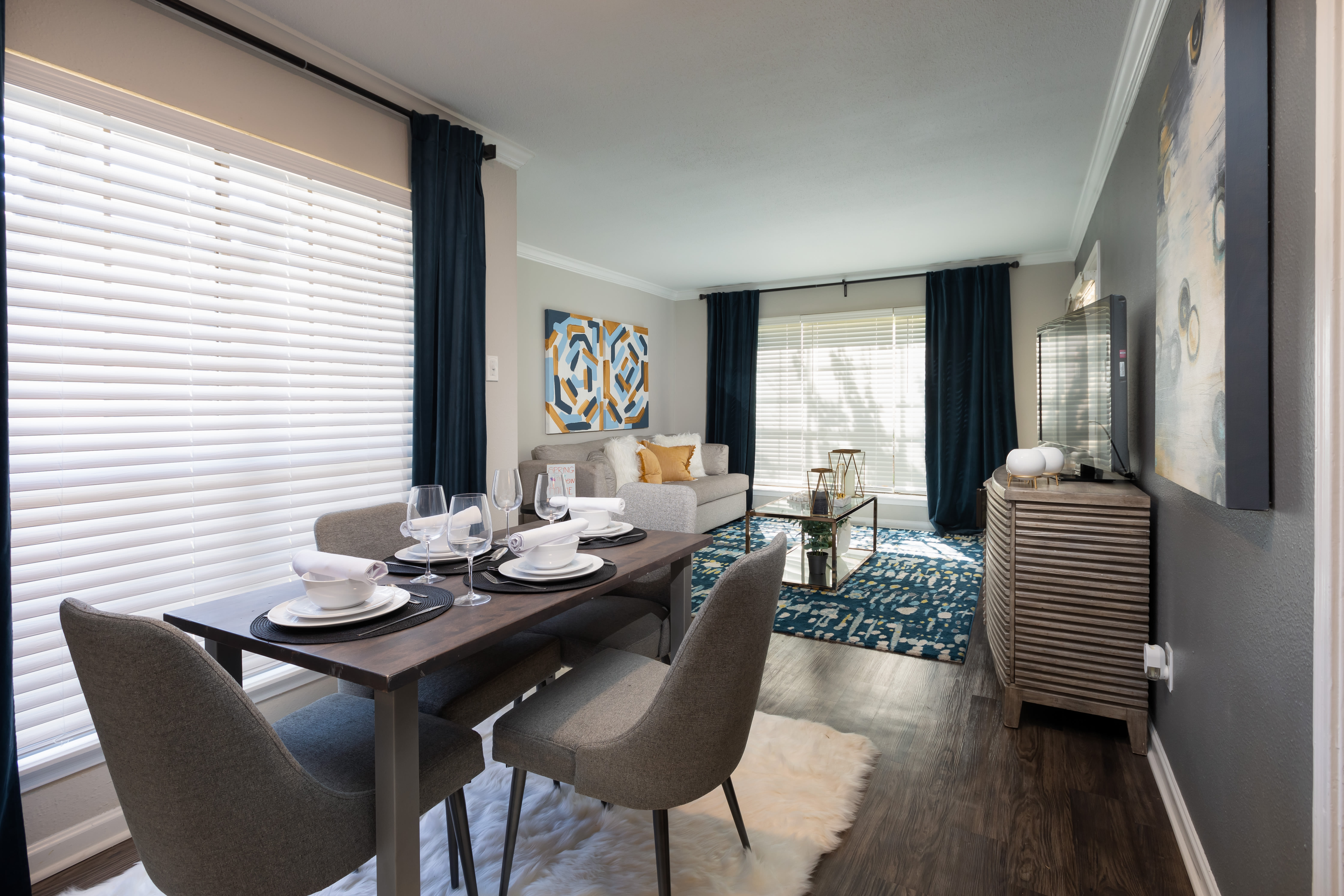 A furnished dining area in an apartment at McAlister in Webster, Texas
