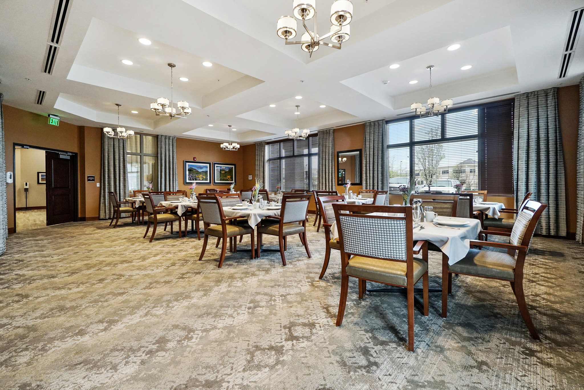 Dining room with carpet floors at Western Slope Memory Care in Grand Junction in Colorado