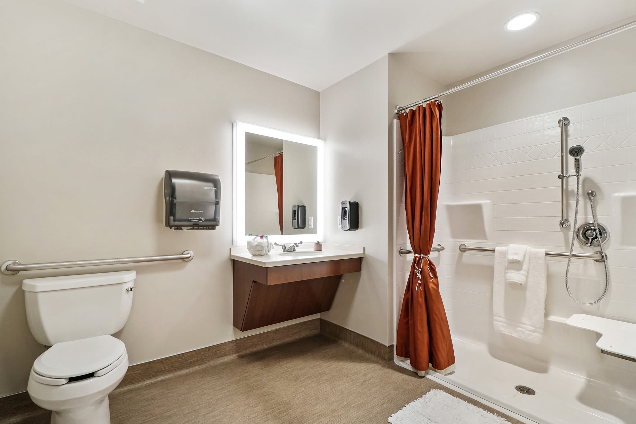 Accessible bathroom with shower and shower seat at Western Slope Memory Care in Grand Junction in Colorado