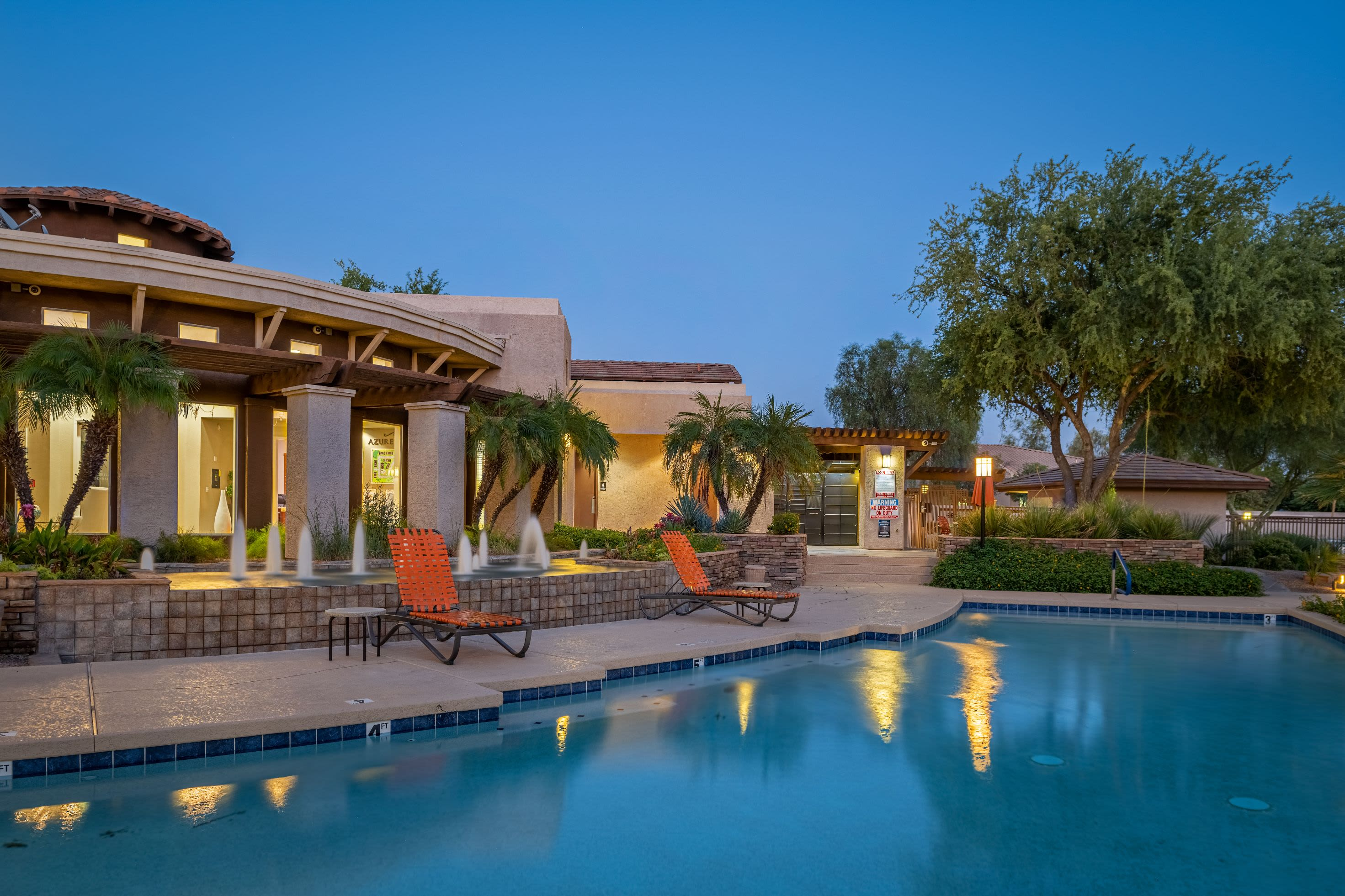 Resort-style pool with sun chairs at Azure Creek in Cave Creek, Arizona