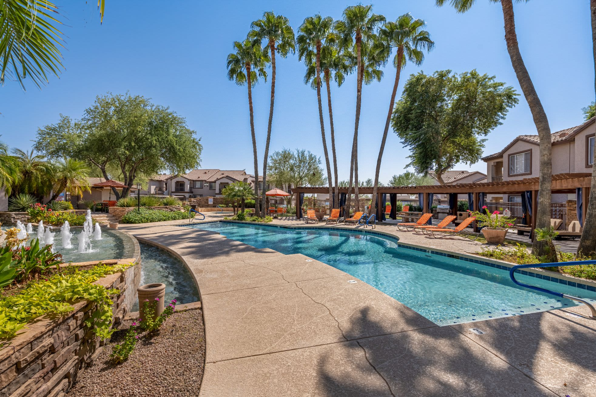 Swimming pool surrounded by vibrant landscaping Azure Creek in Cave Creek, Arizona