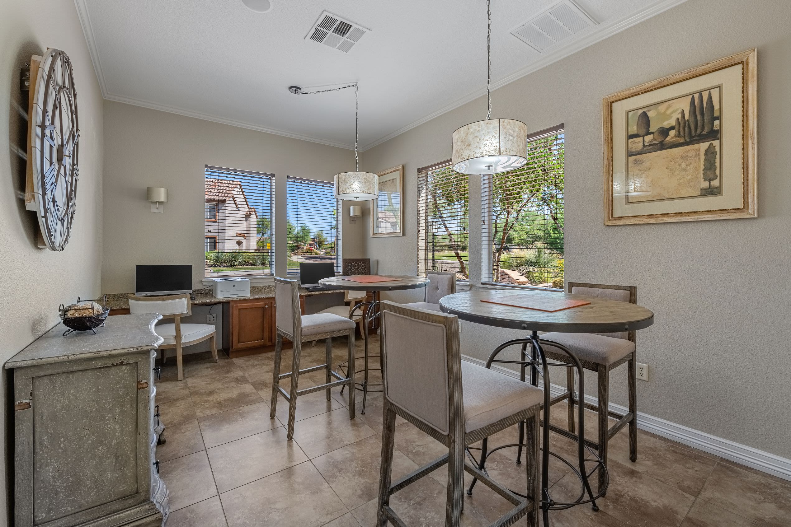 Decorated dining area with large windows at Azure Creek in Cave Creek, Arizona