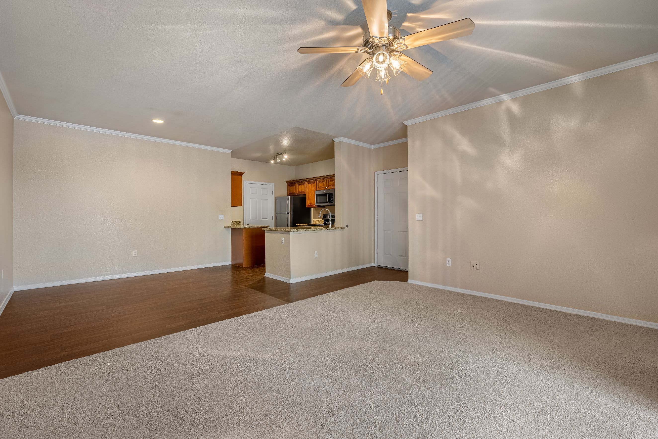 Living room with carpet and a ceiling fan Azure Creek in Cave Creek, Arizona