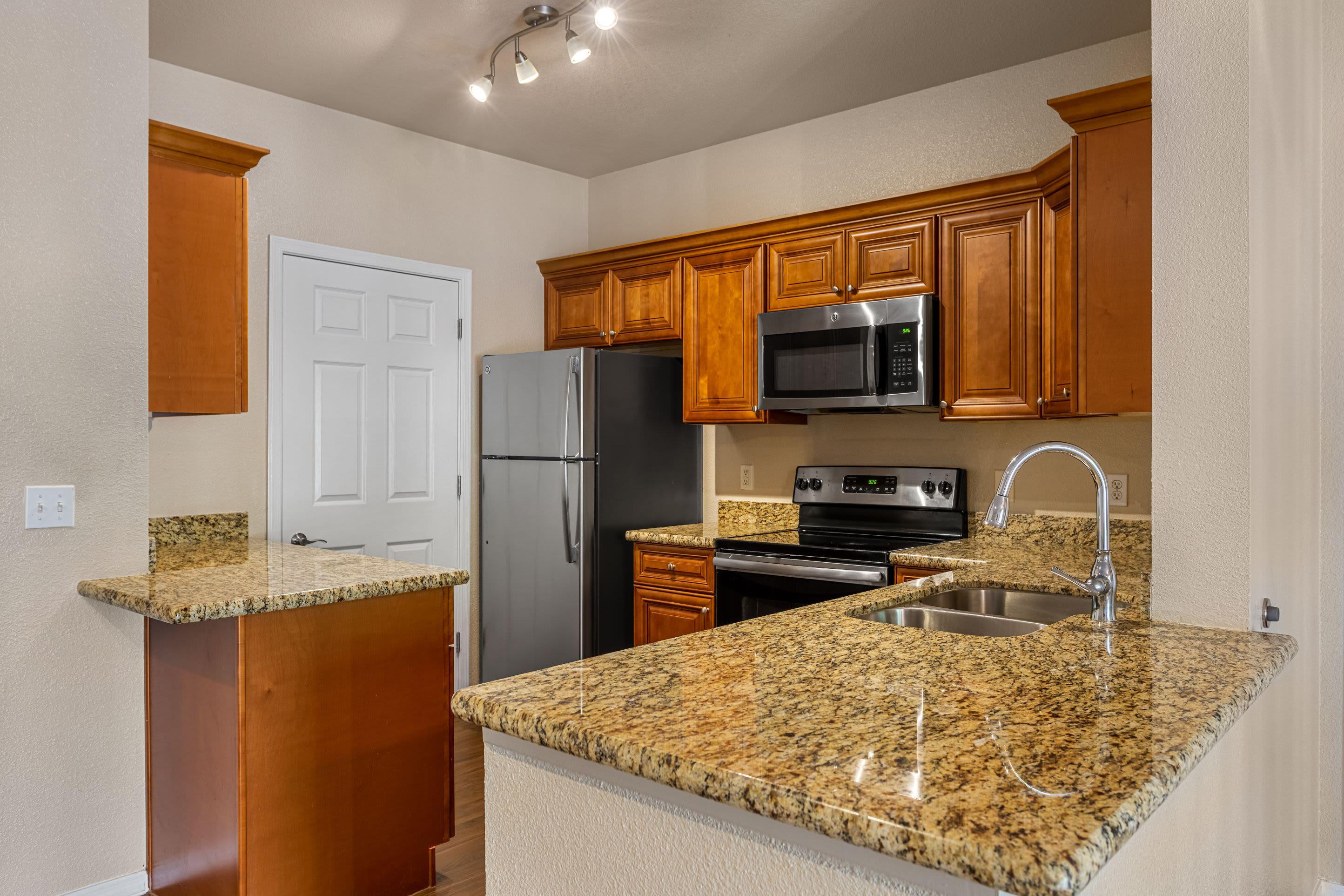 Bright kitchen with modern appliances Azure Creek in Cave Creek, Arizona