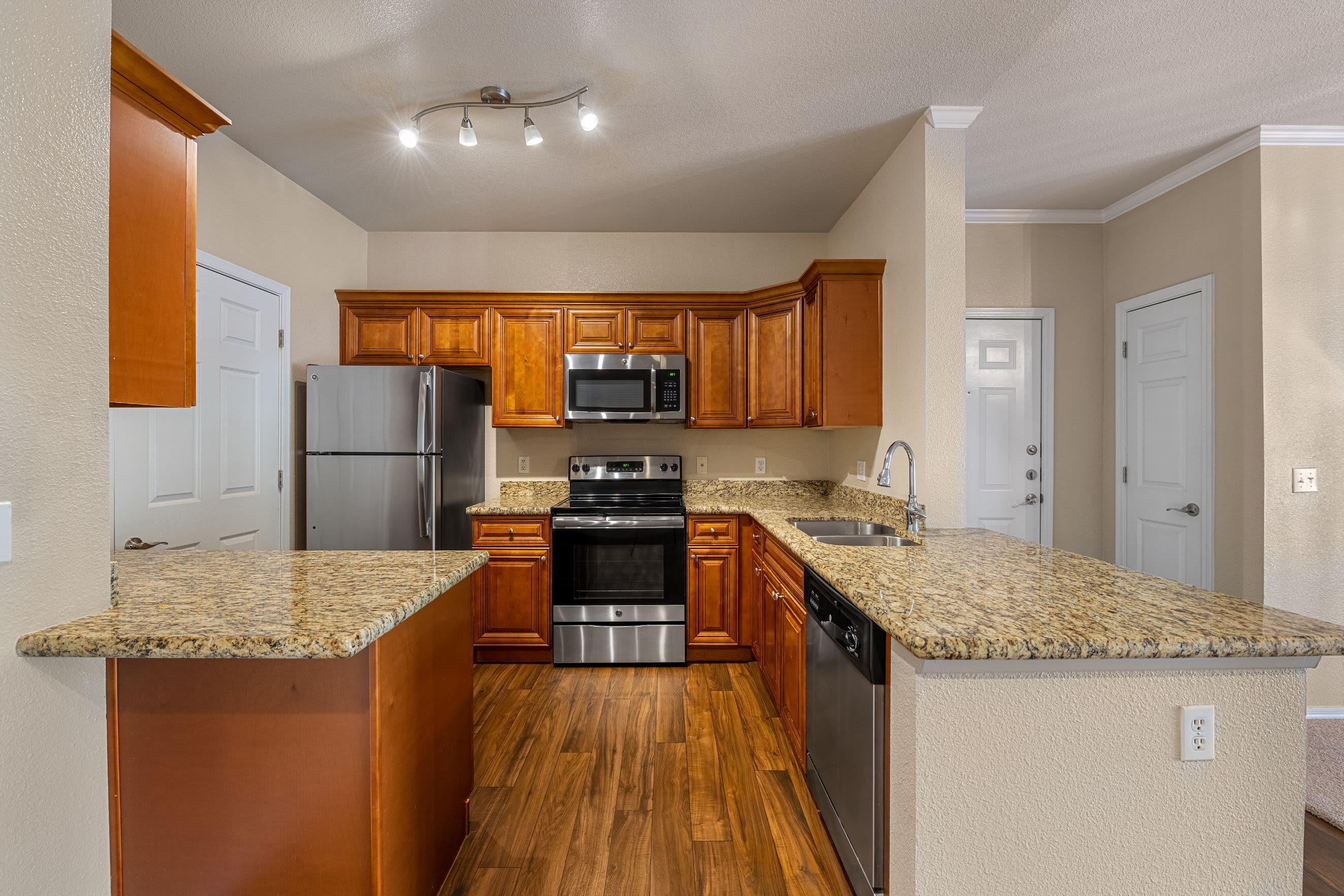 Spacious kitchen with wood style floors Azure Creek in Cave Creek, Arizona