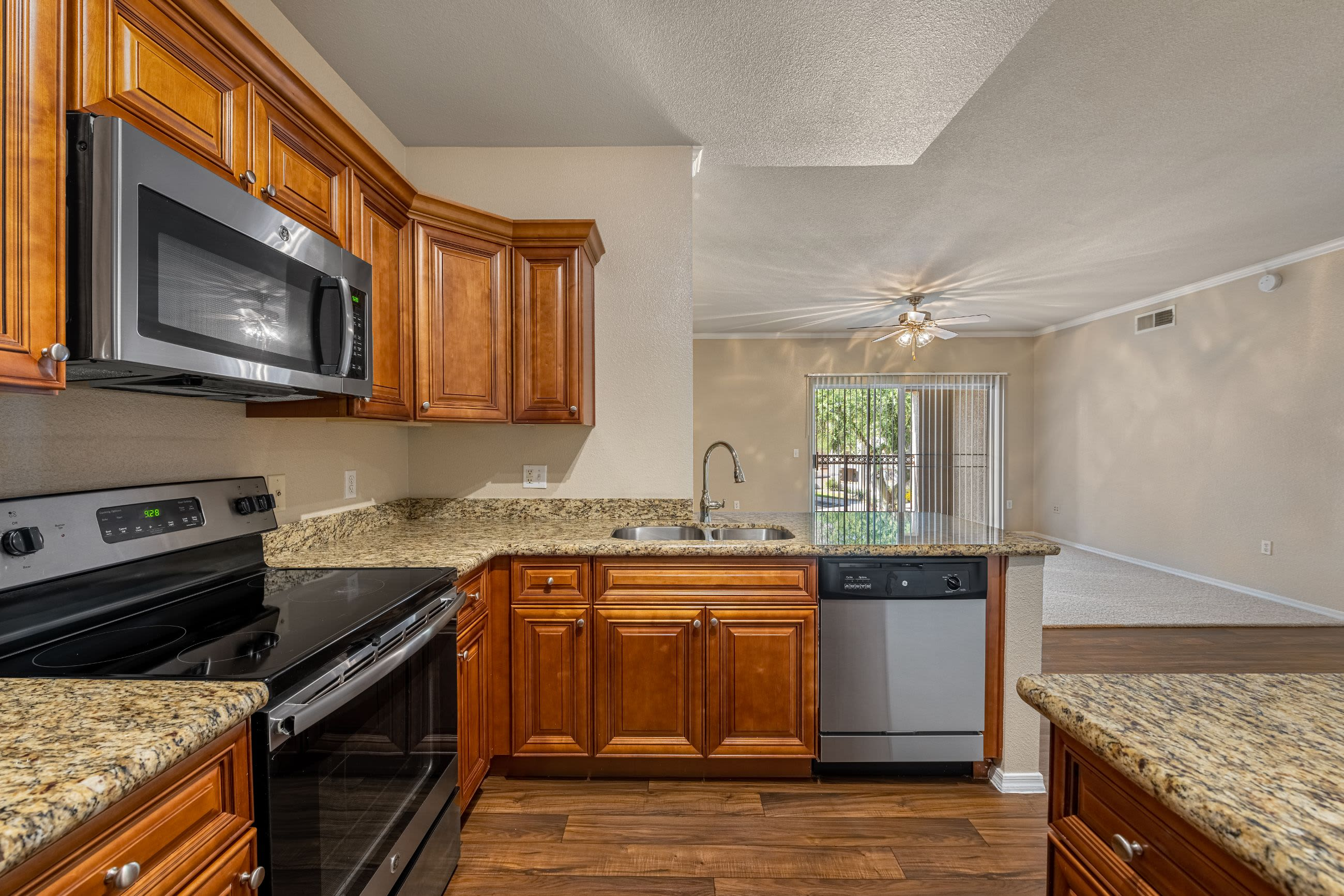 Modern kitchen with wood style floors Azure Creek in Cave Creek, Arizona