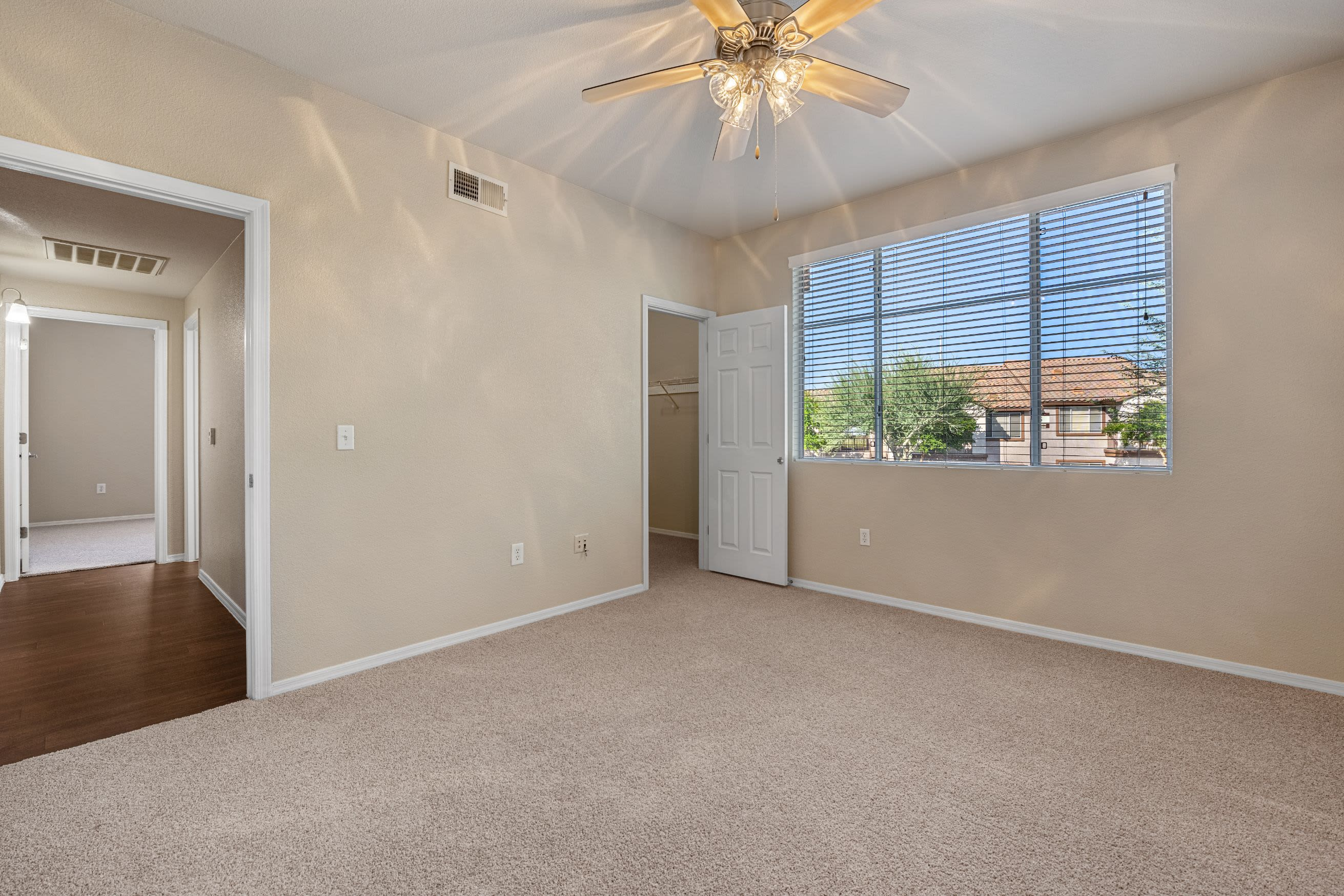 Bedroom with carpet and a ceiling fan at Azure Creek in Cave Creek, Arizona