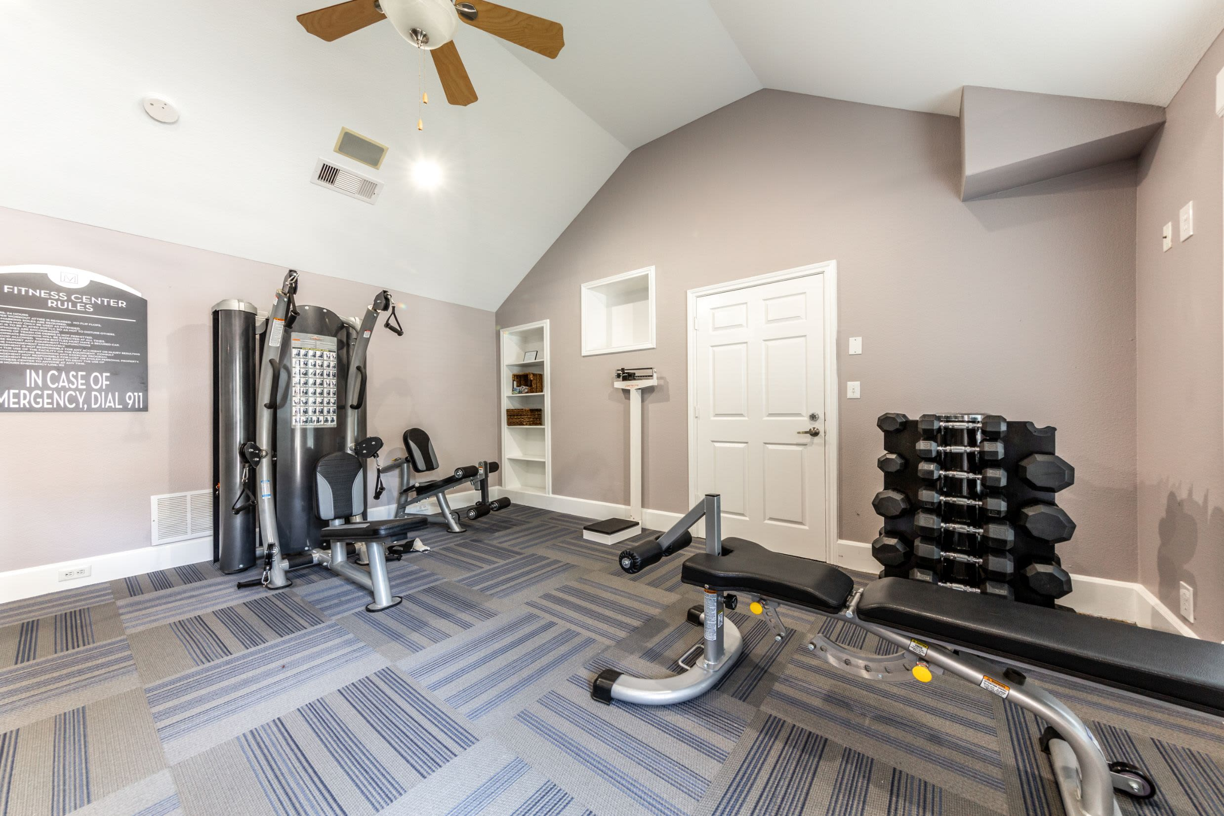 Fitness center with free weights at Marquis on Memorial in Houston, Texas