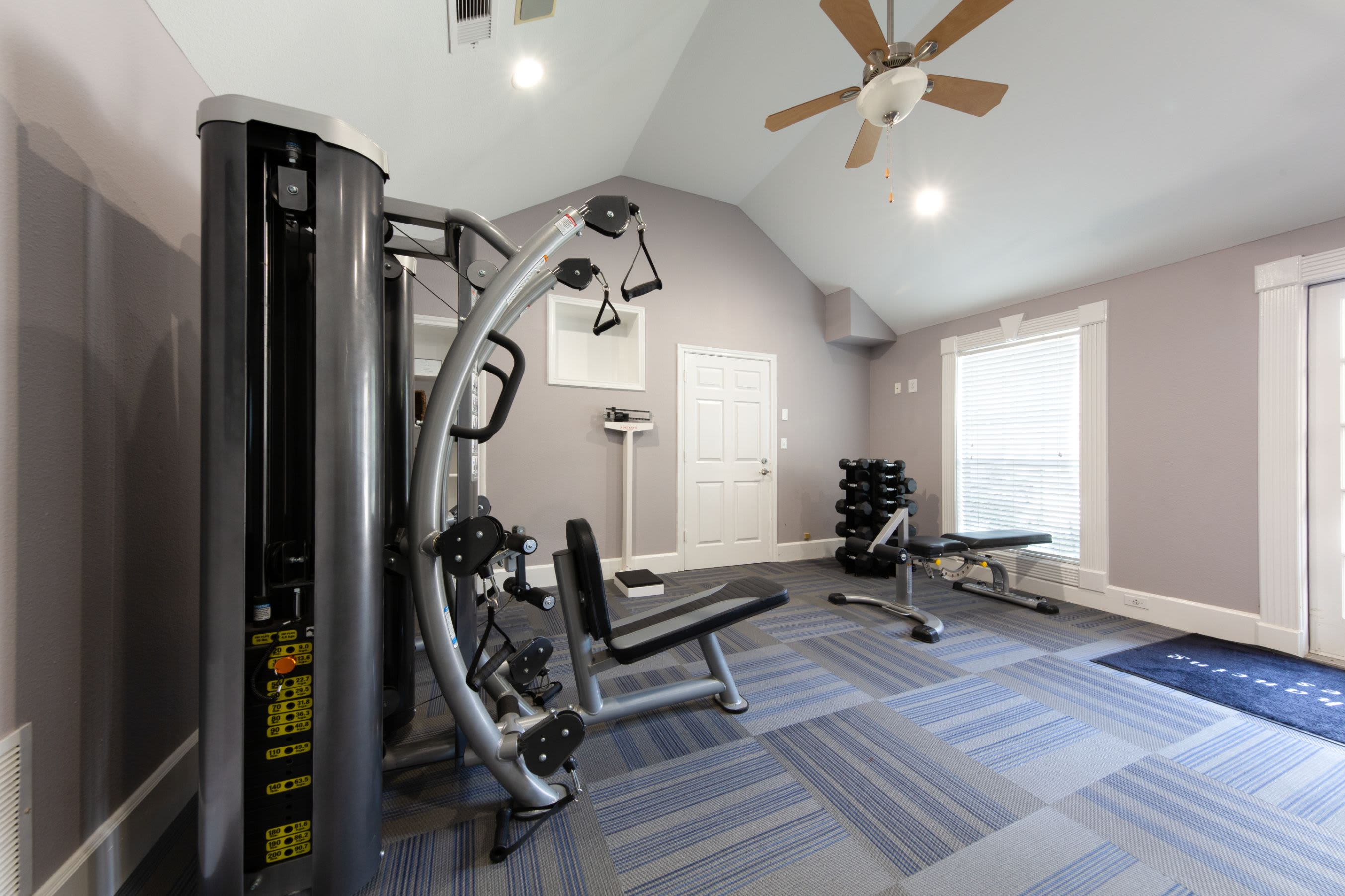 Fitness center with cable machine at Marquis on Memorial in Houston, Texas
