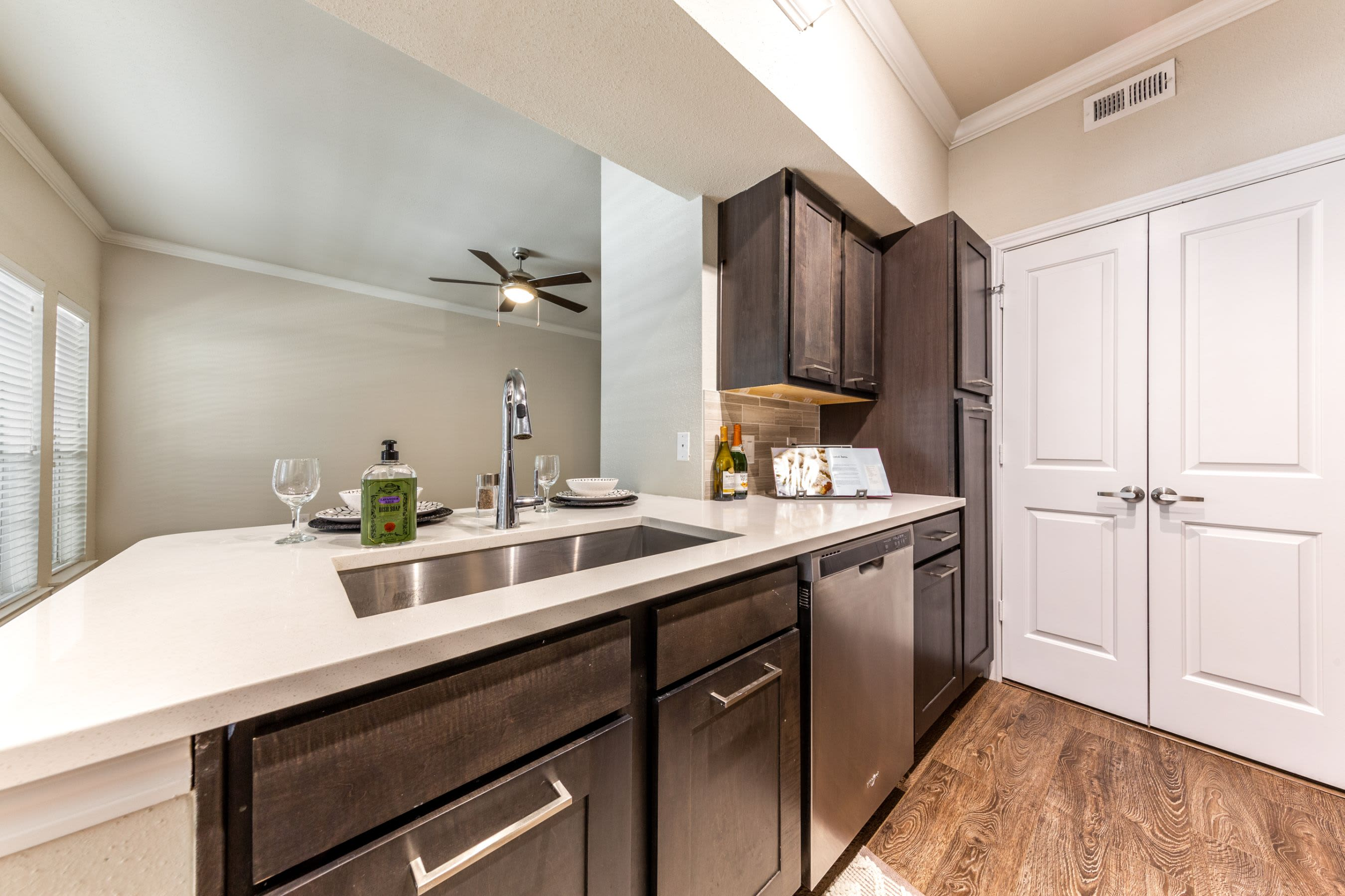 Modern kitchen with white countertops at Marquis on Memorial in Houston, Texas