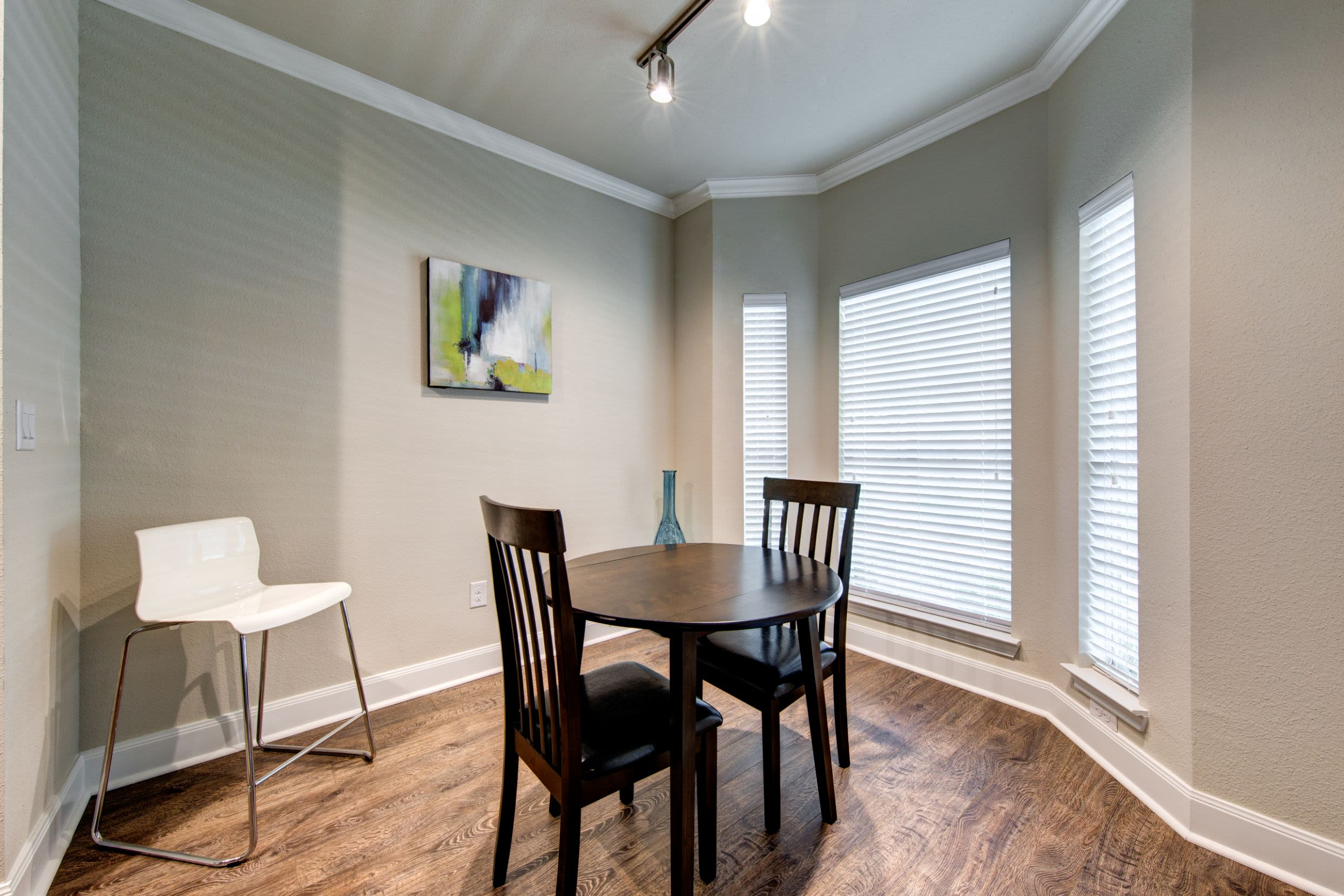 Dining area with three large windows at Marquis on Memorial in Houston, Texas