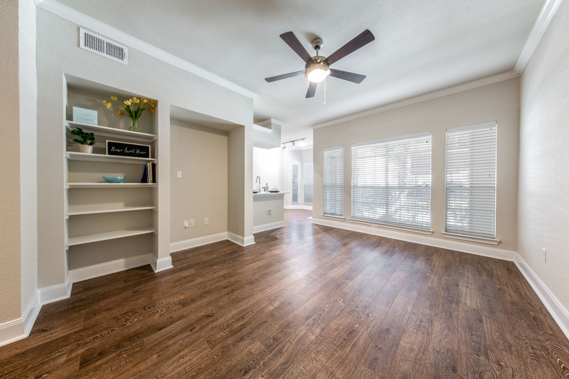 Living area with wood style flooring at Marquis on Memorial in Houston, Texas