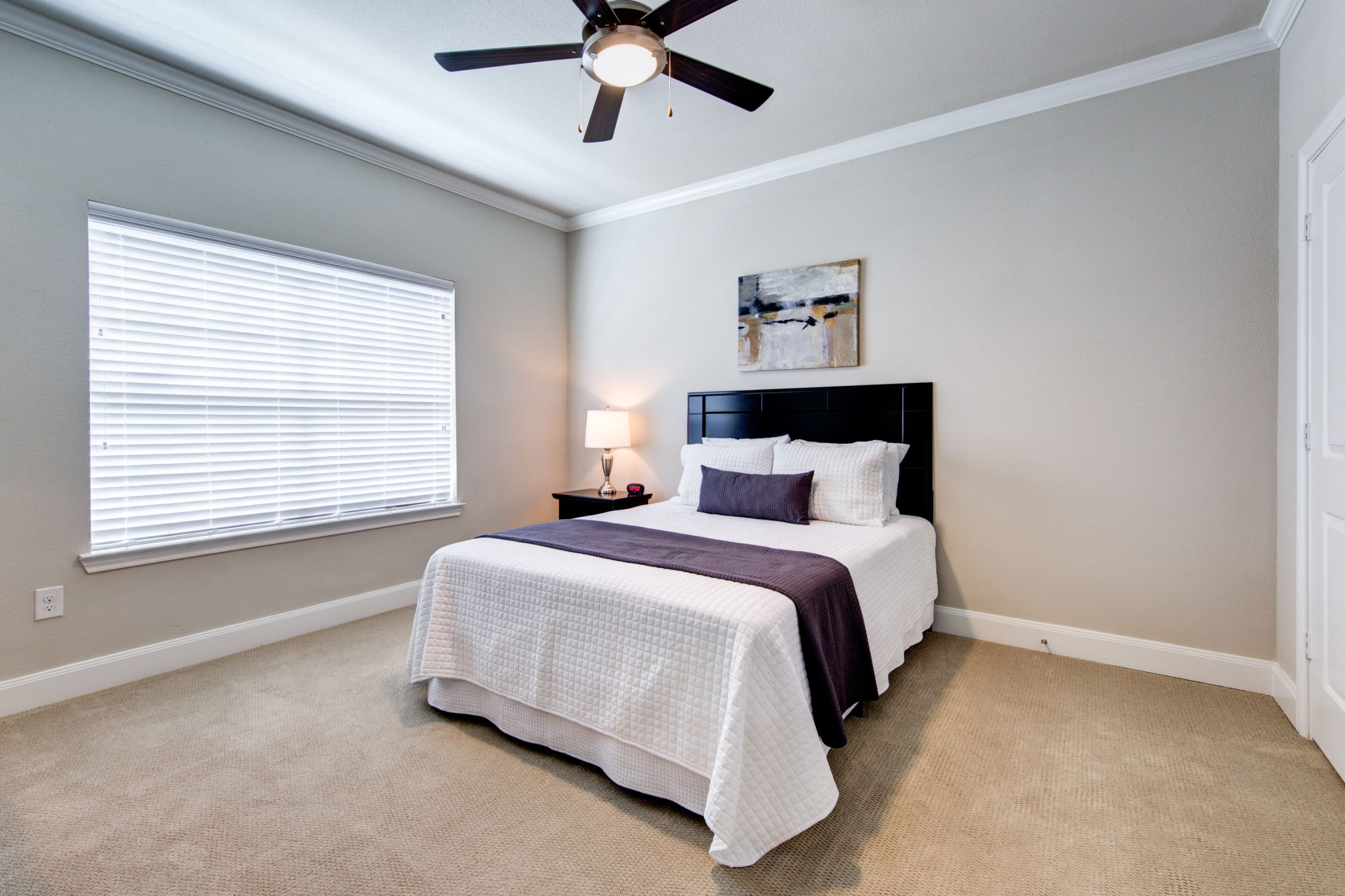 Bedroom with ceiling fan at Marquis on Memorial in Houston, Texas