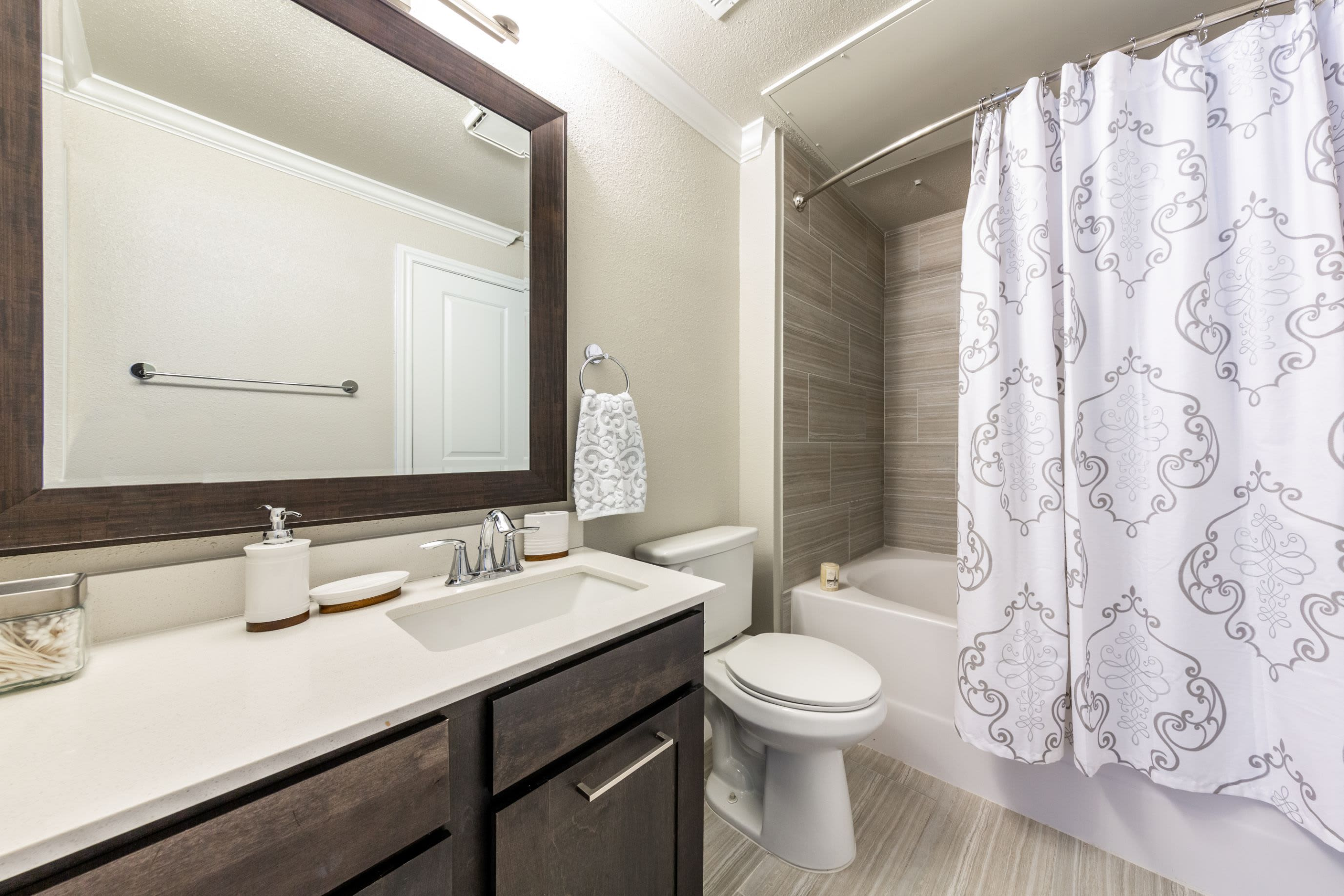 Bathroom with white countertops at Marquis on Memorial in Houston, Texas