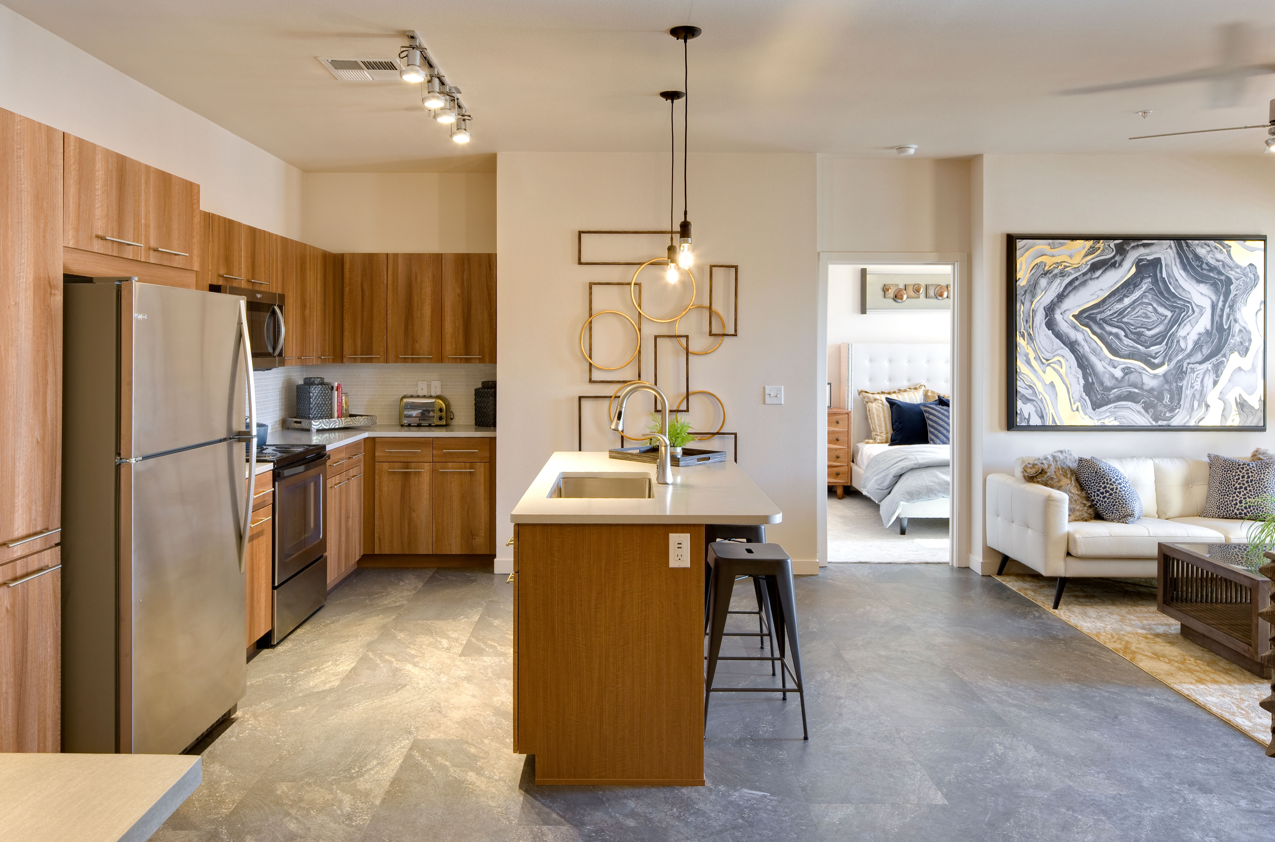 Open-concept floor plan with kitchen island and living area at Olympus Alameda in Albuquerque, New Mexico