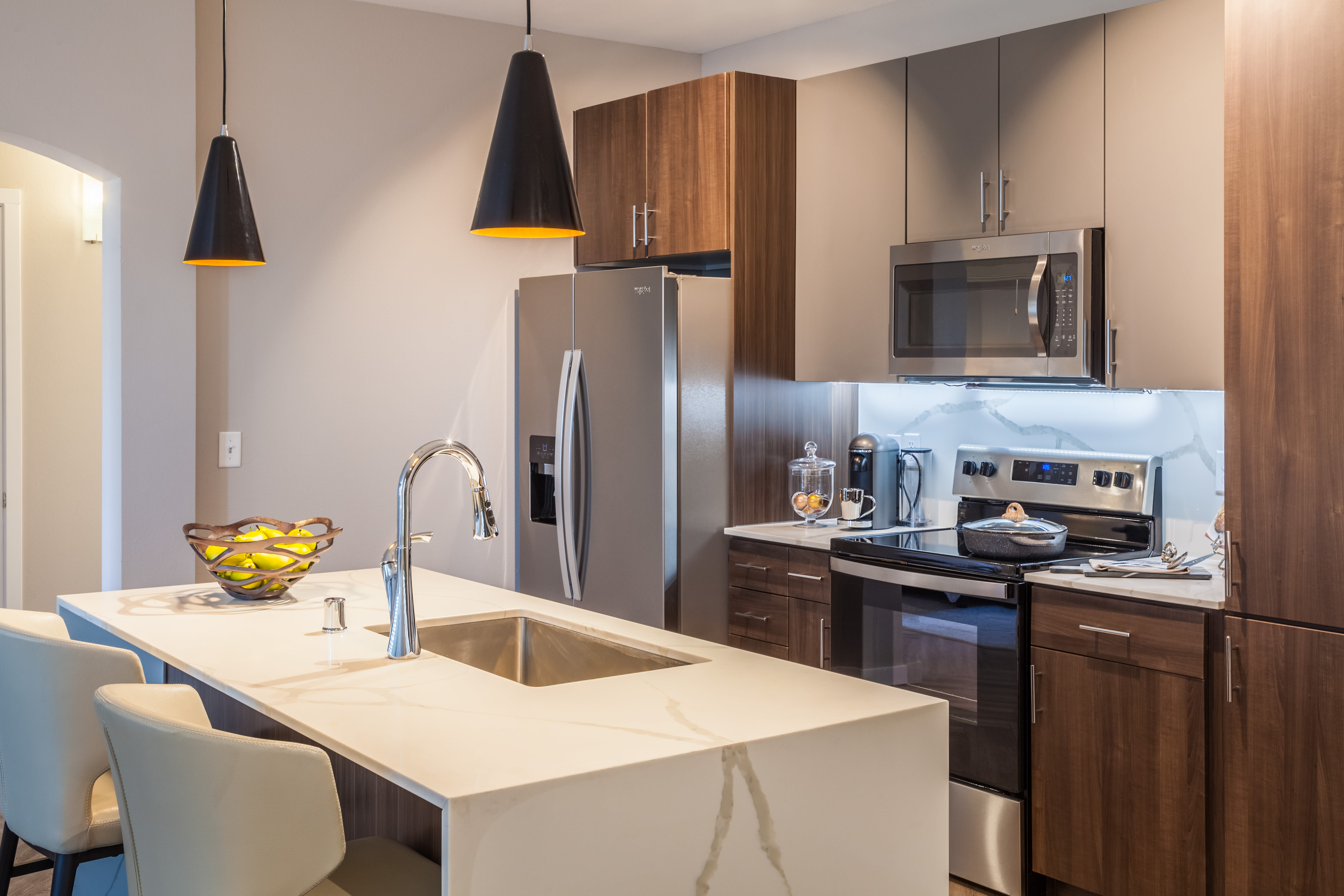 Stainless-steel appliances and an island in a model home's kitchen at Olympus Alameda in Albuquerque, New Mexico