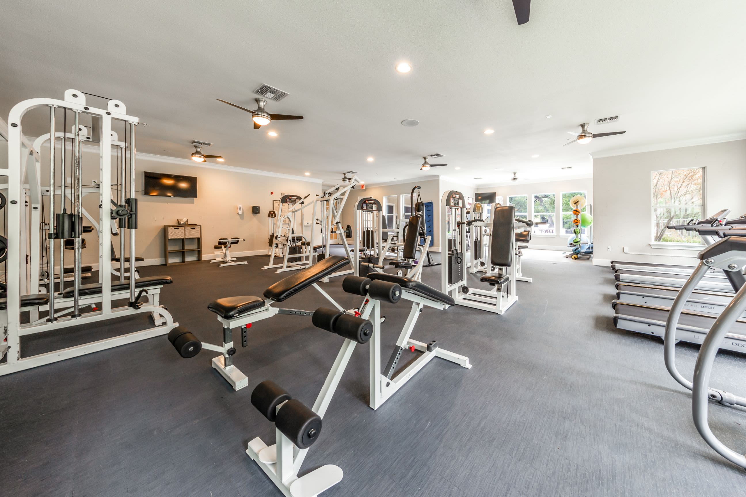 Benches and racks in fitness center Marquis at TPC in San Antonio, Texas