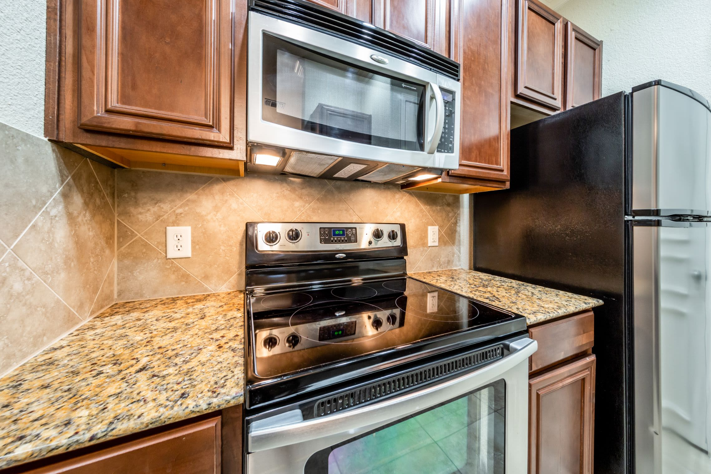 Kitchen with modern appliances at Marquis at TPC in San Antonio, Texas