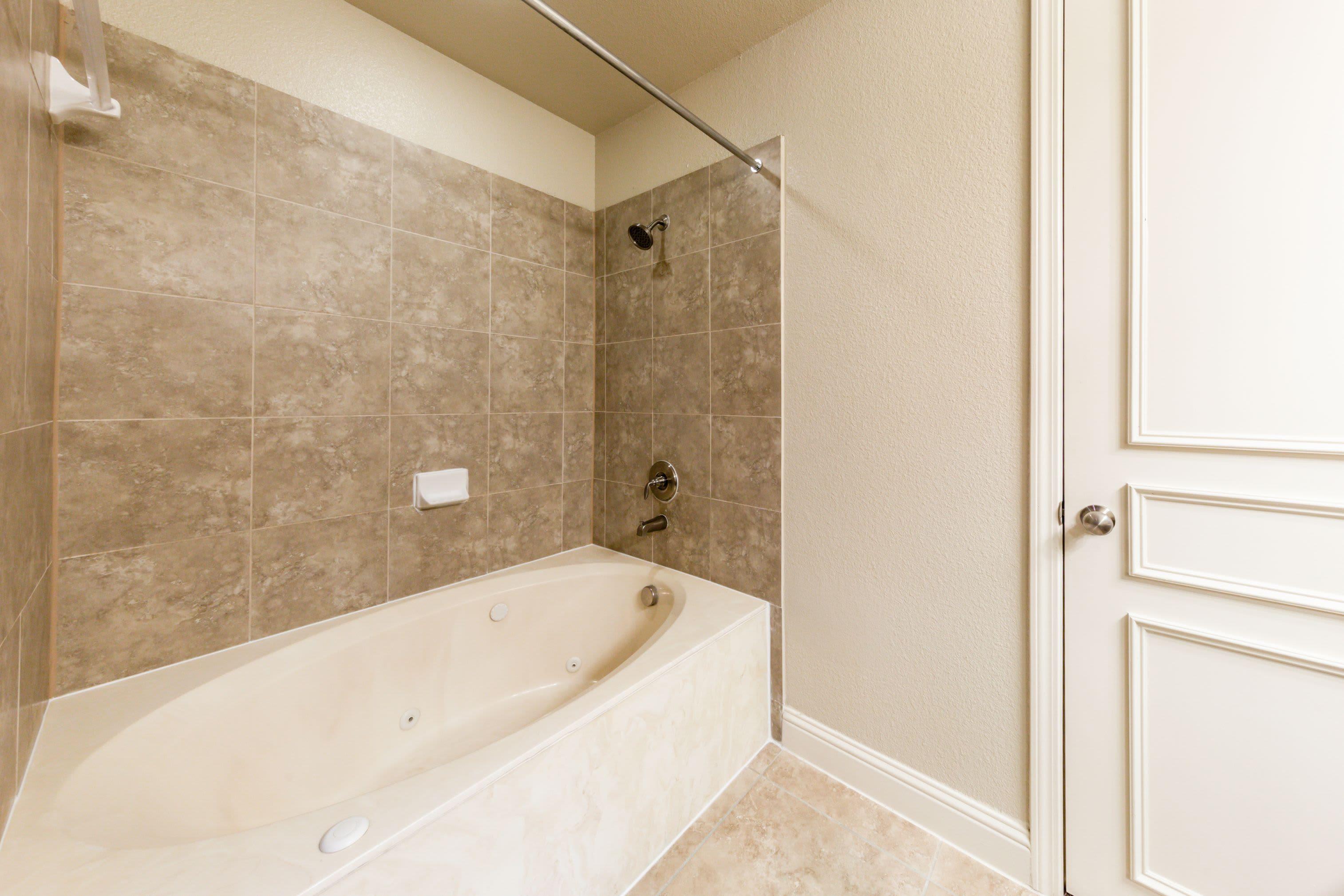 Bathroom with oval bath tub at Marquis at TPC in San Antonio, Texas