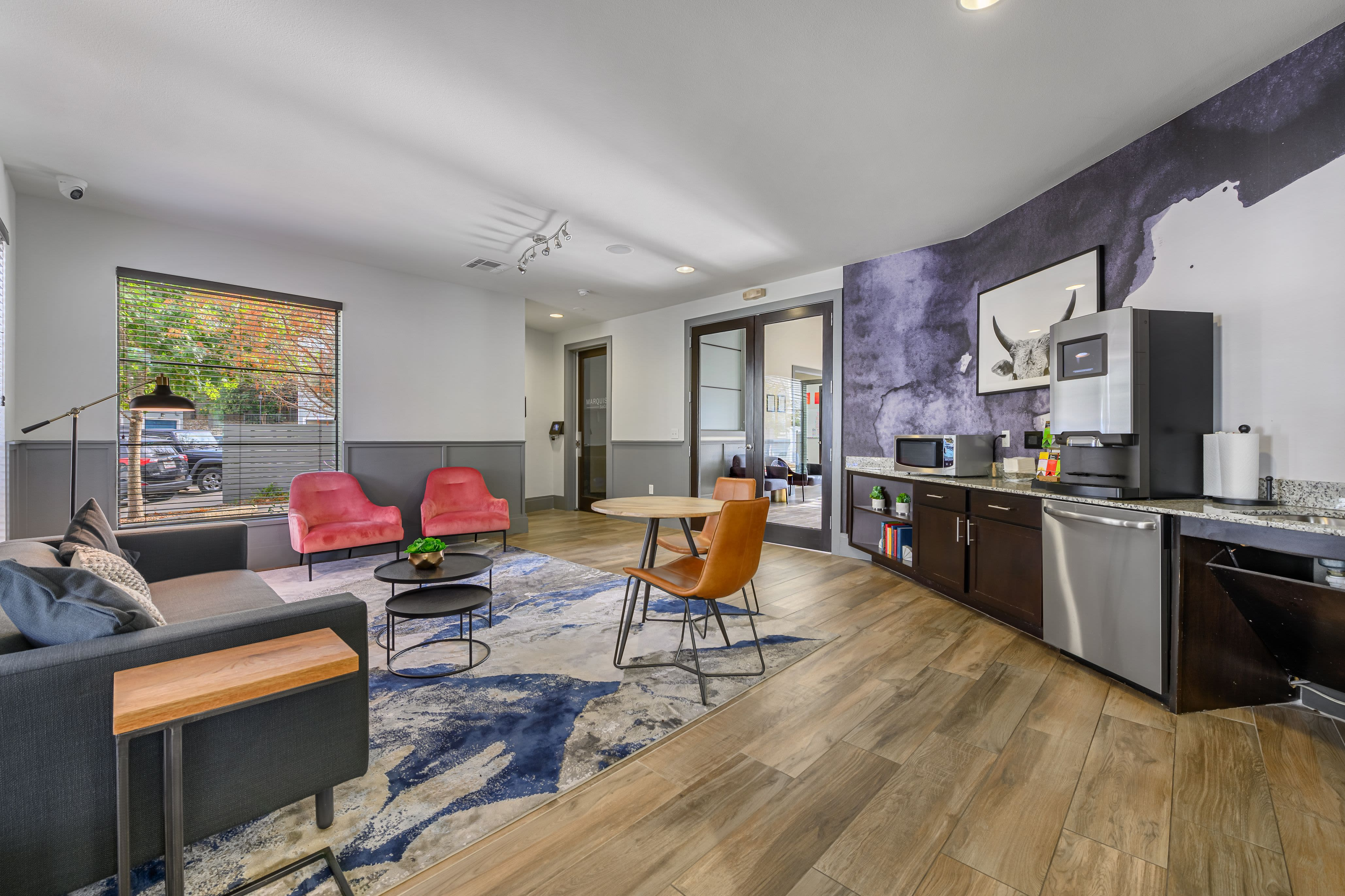 Spacious clubhouse with refreshment bar at Marquis SoCo in Austin, Texas
