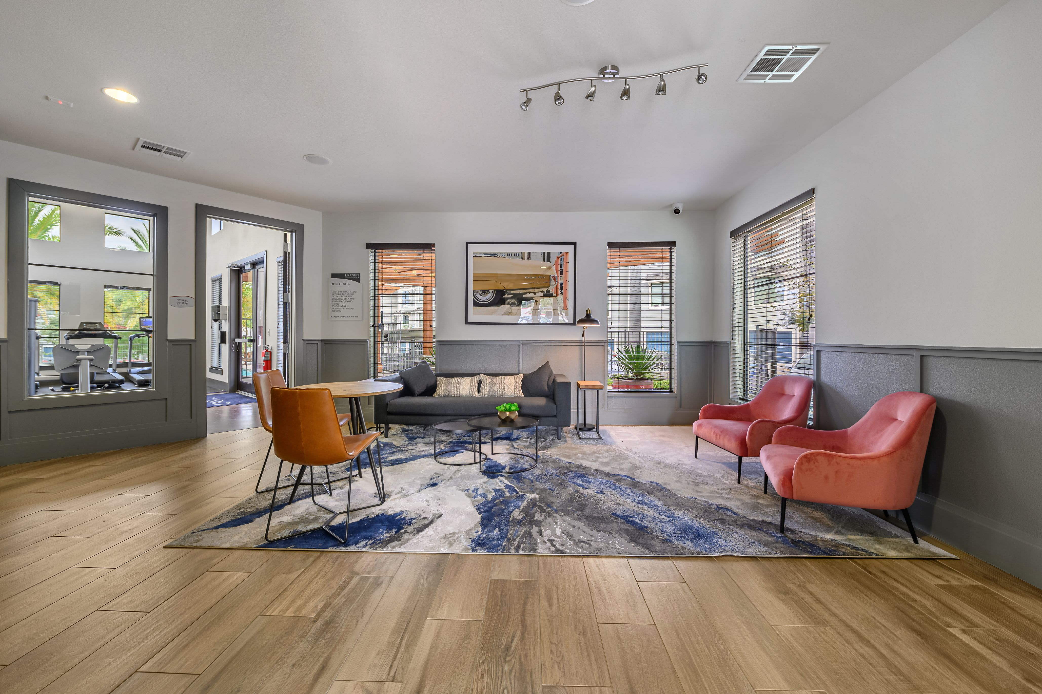 Spacious clubhouse with wood style floors at Marquis SoCo in Austin, Texas