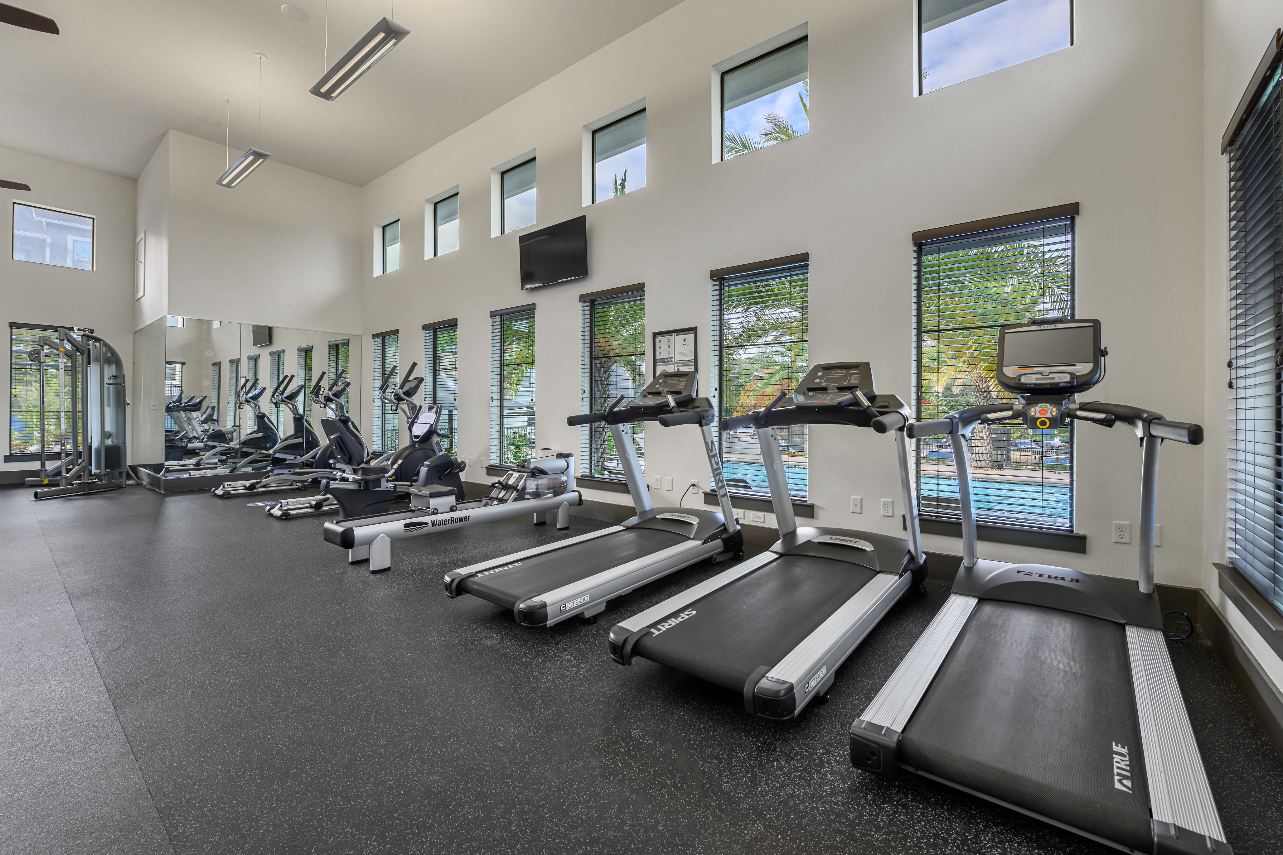 Row of treadmills in fitness center at Marquis SoCo in Austin, Texas