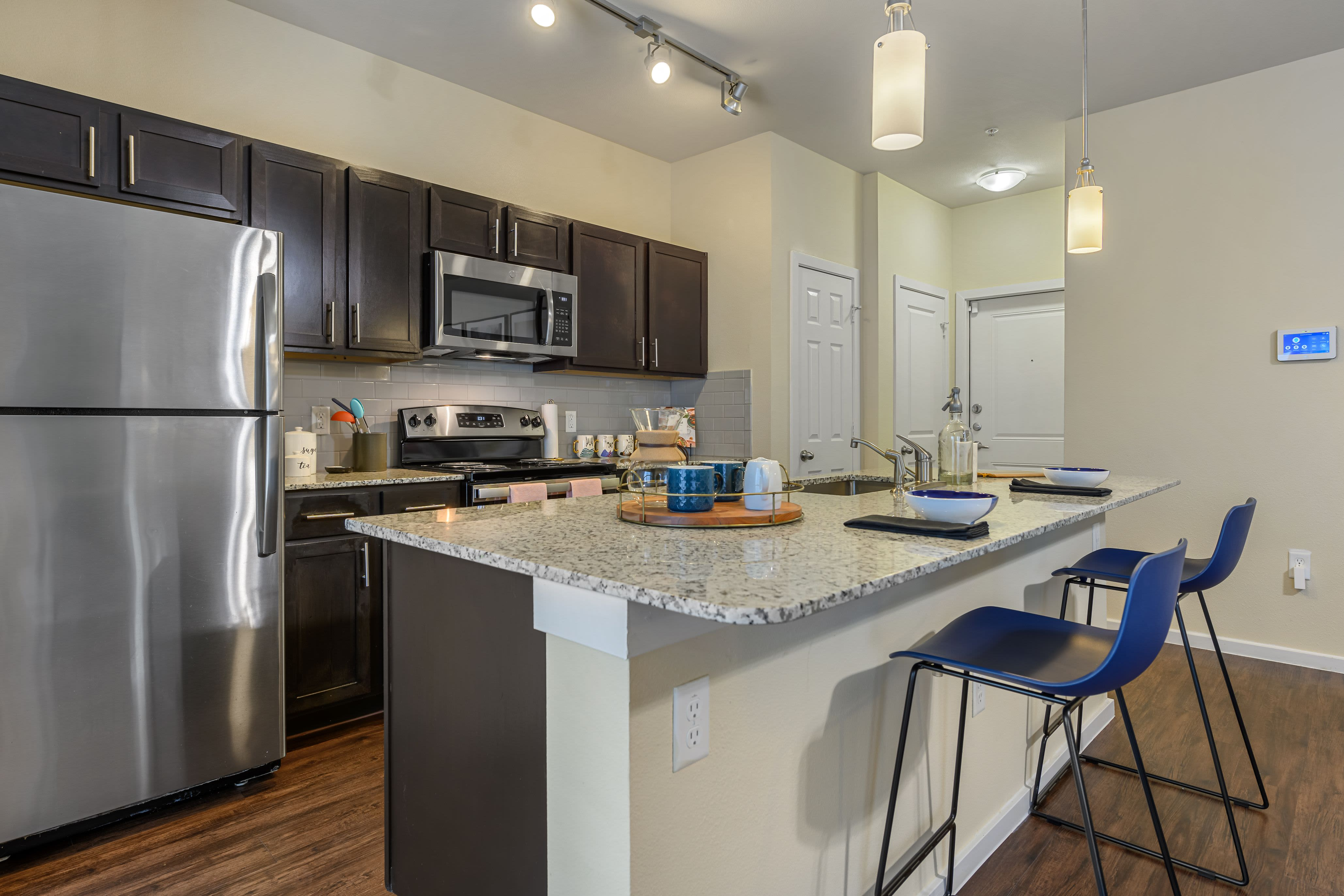 Spacious kitchen with breakfast bar at Marquis SoCo in Austin, Texas