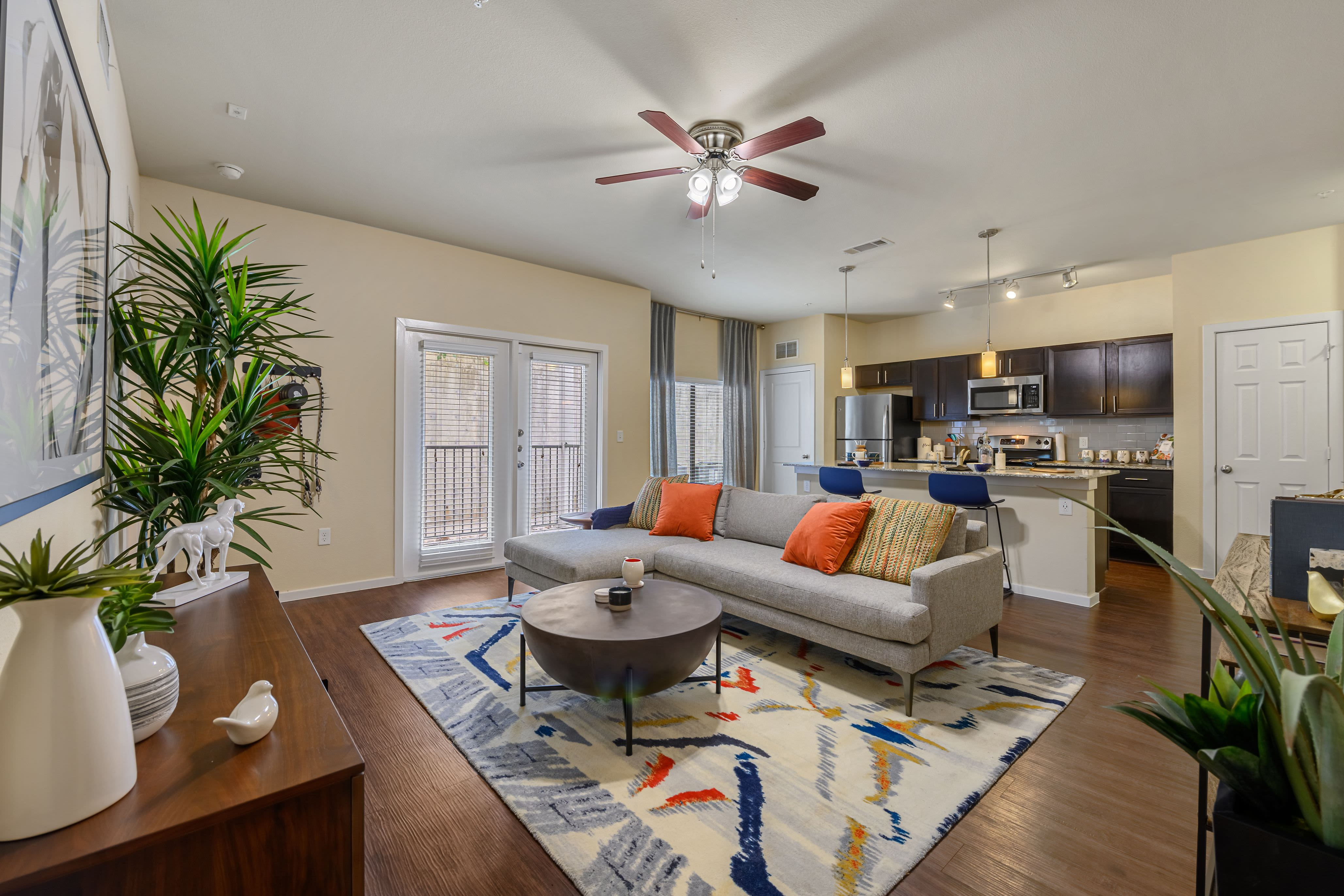 Bright living room with rug at Marquis SoCo in Austin, Texas