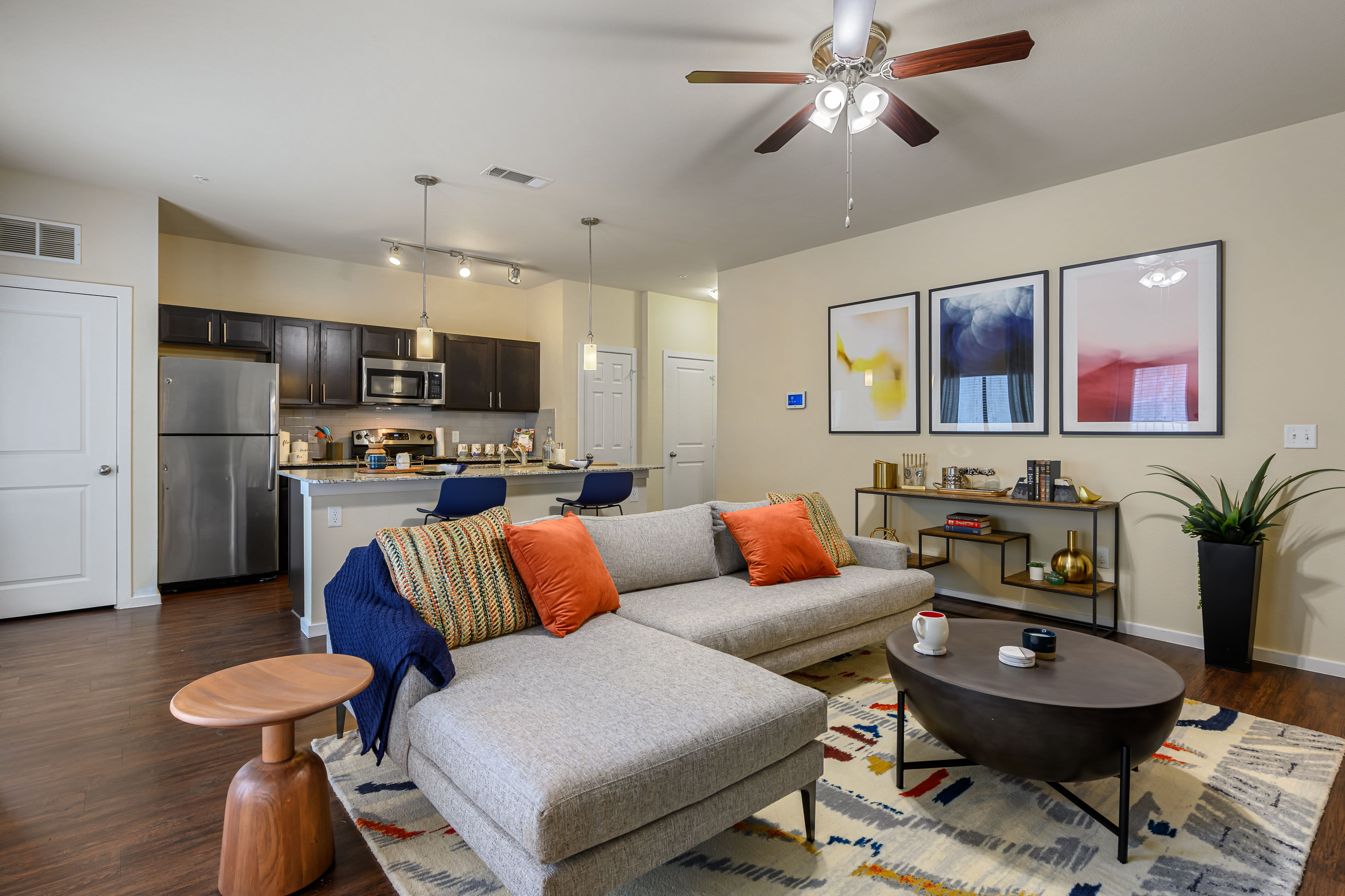 Living room with ceiling fan at Marquis SoCo in Austin, Texas