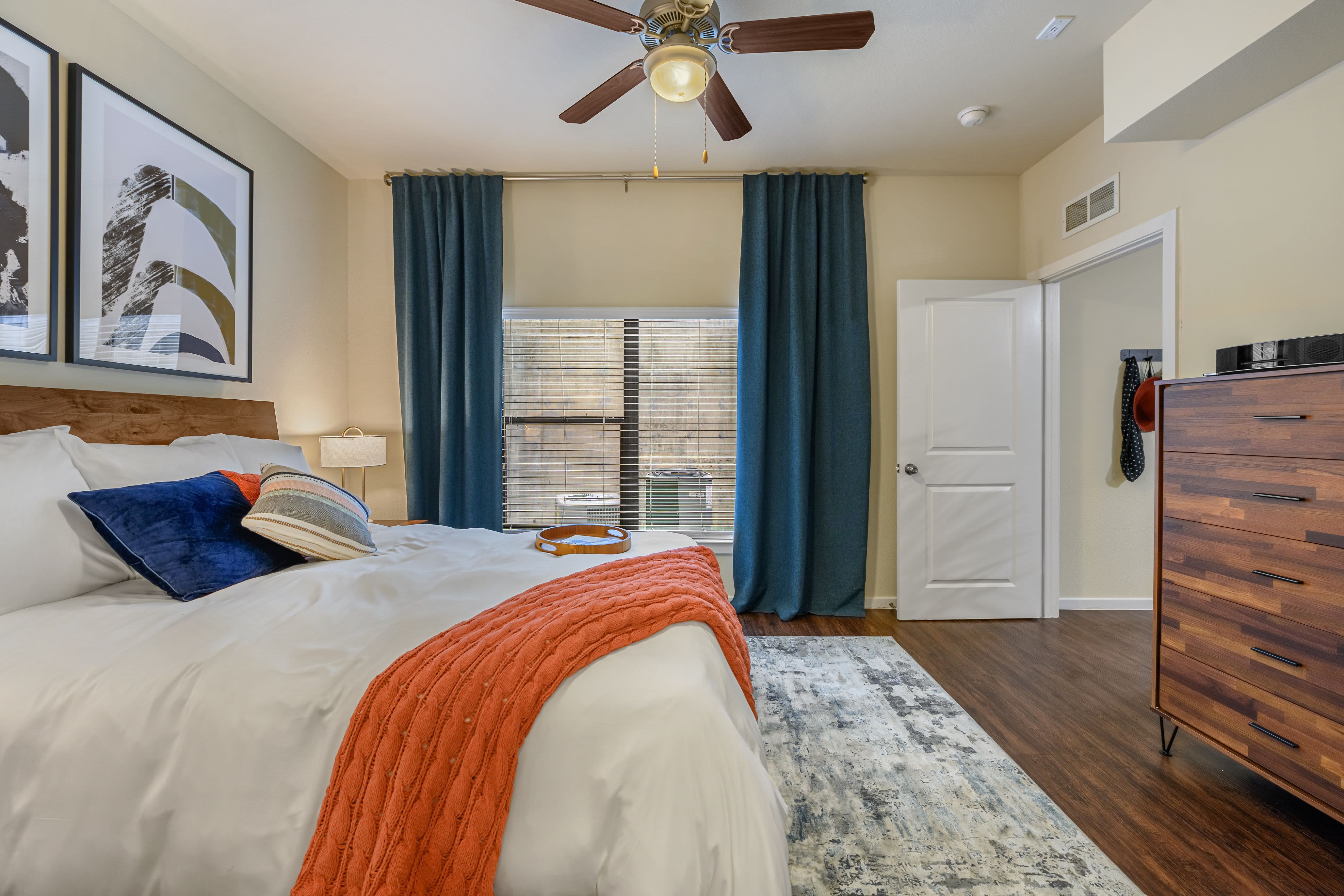 Bedroom with wood style flooring and rug at Marquis SoCo in Austin, Texas