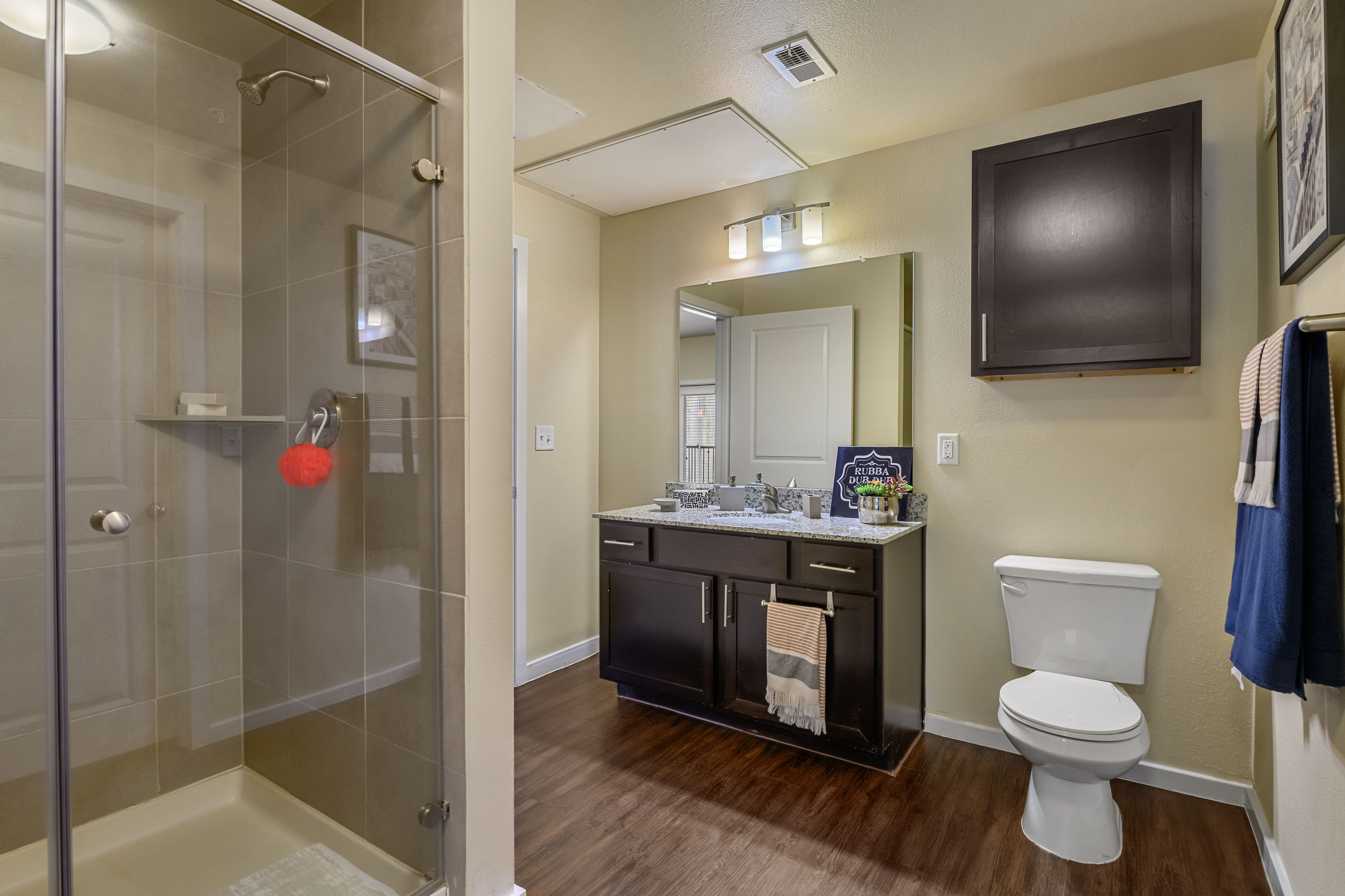Large bathroom with glass shower at Marquis SoCo in Austin, Texas